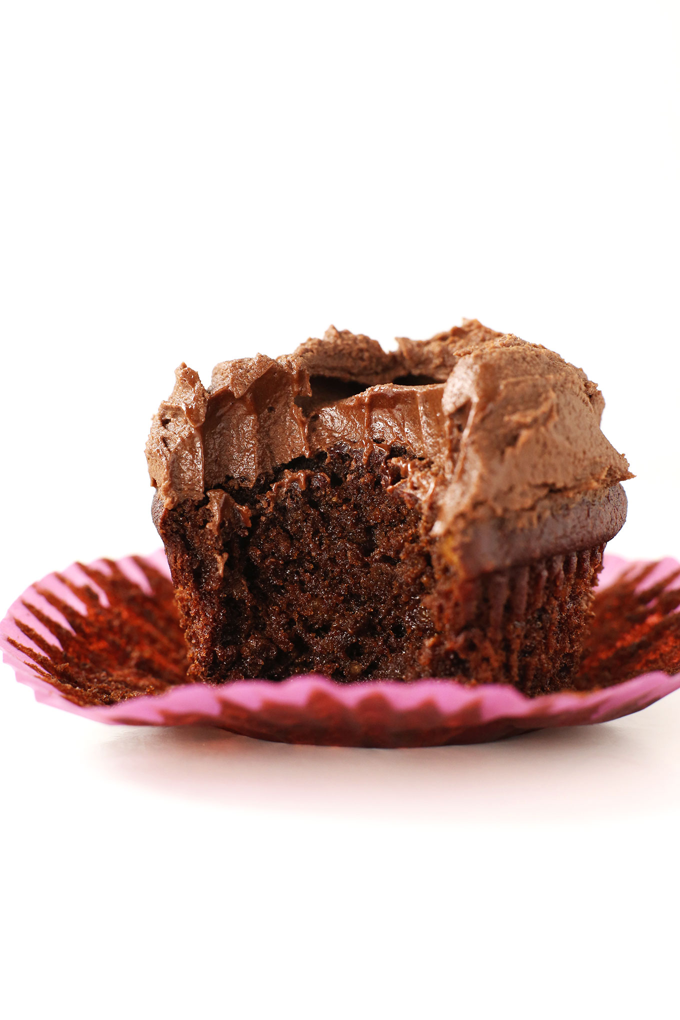 The Best Vegan Gluten-Free Chocolate Cupcake resting on a cupcake wrapper