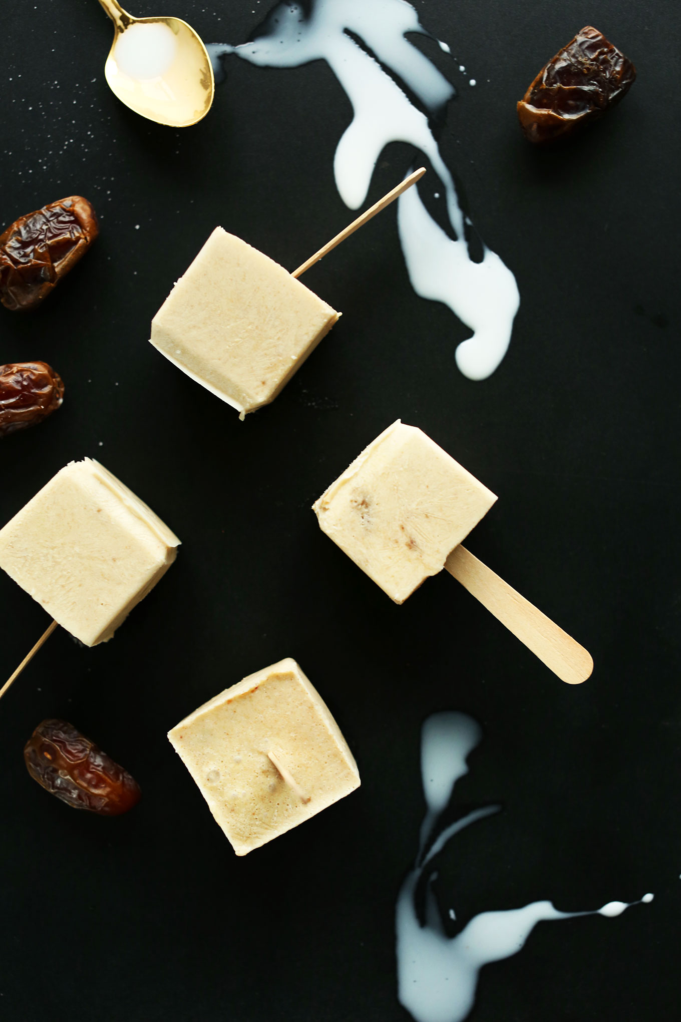 Salty and sweet Dulce De Leche Pops alongside date and spoons of coconut milk