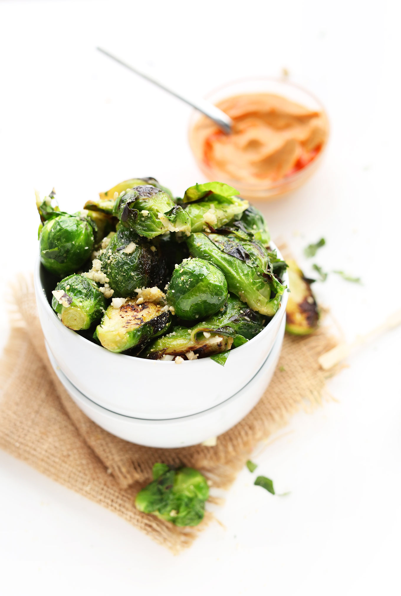 Bowl of Crispy Roasted Brussels Sprouts to be dipped in our spicy Sriracha Aioli recipe