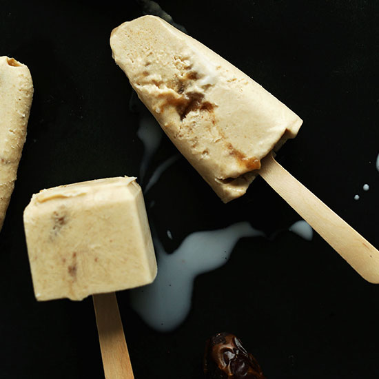 Baking sheet with Creamy Dulce de Leche Pops on wooden popsicle sticks