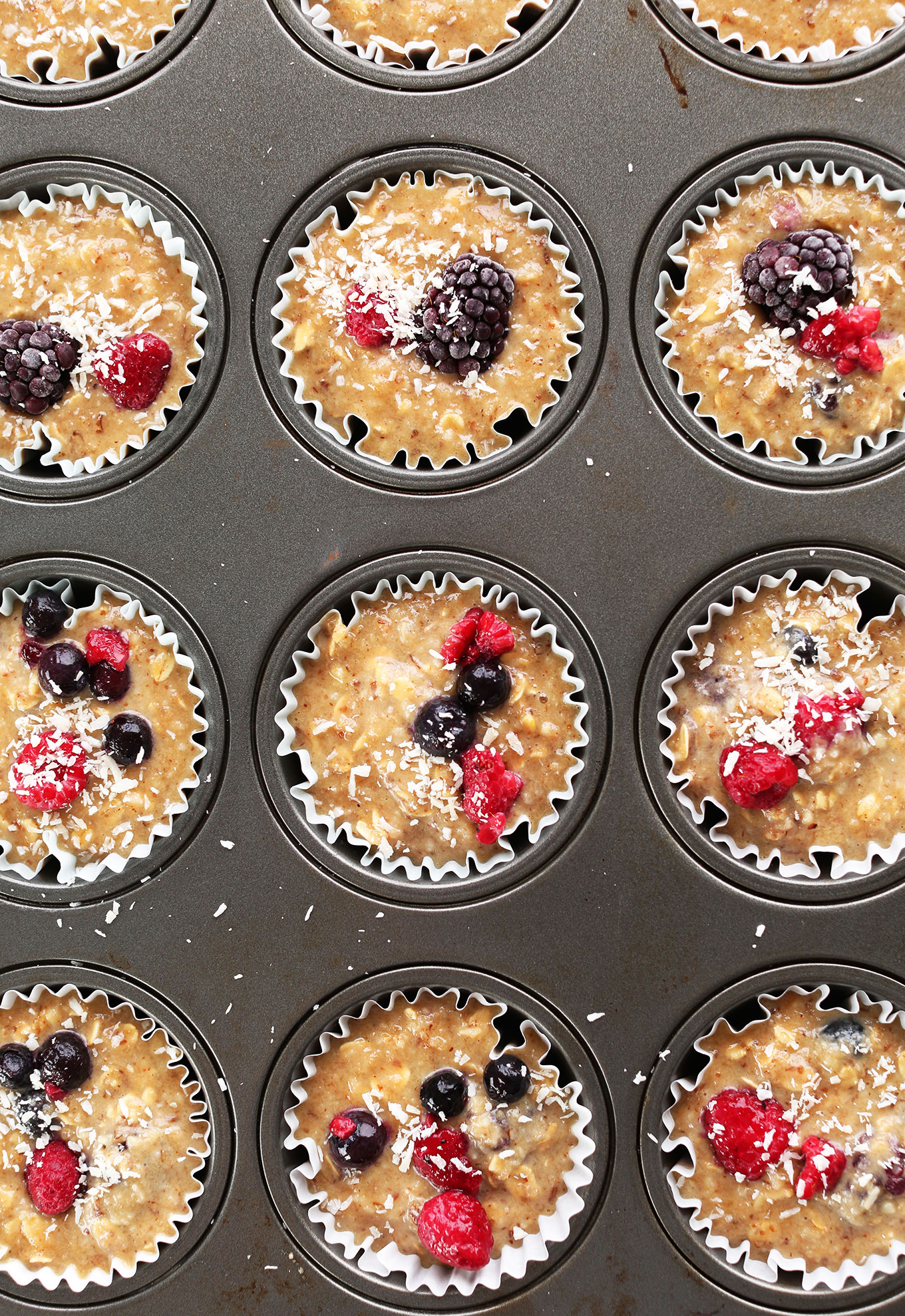 Muffin tin filled with our gluten-free vegan Berry Coconut Muffins recipe