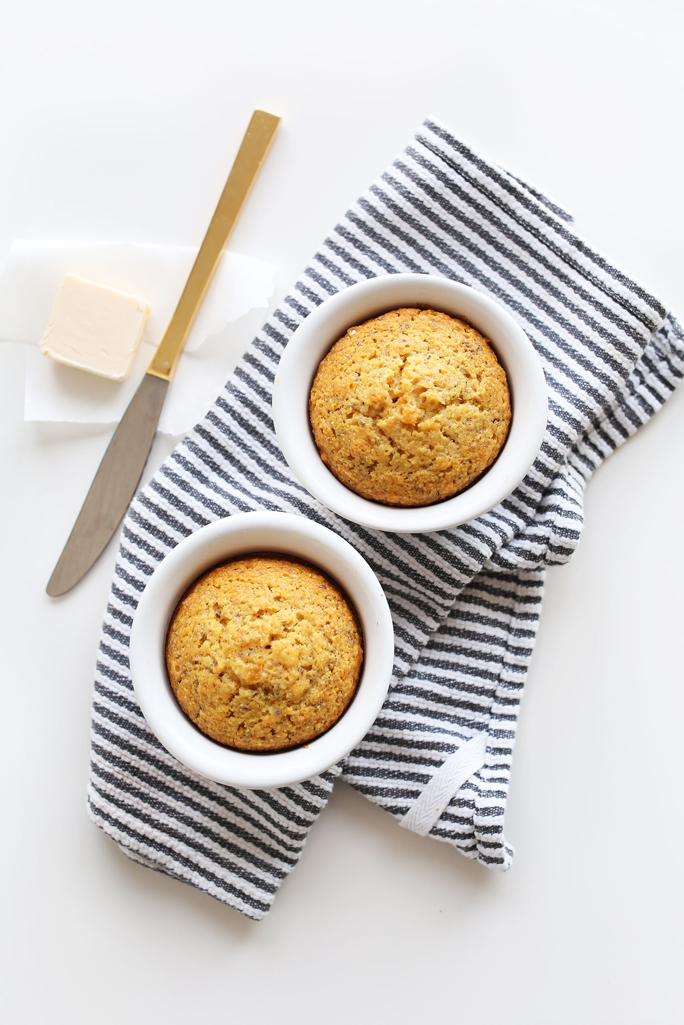 Two Vegan Cornbread Muffins in ramekins to be served with chili