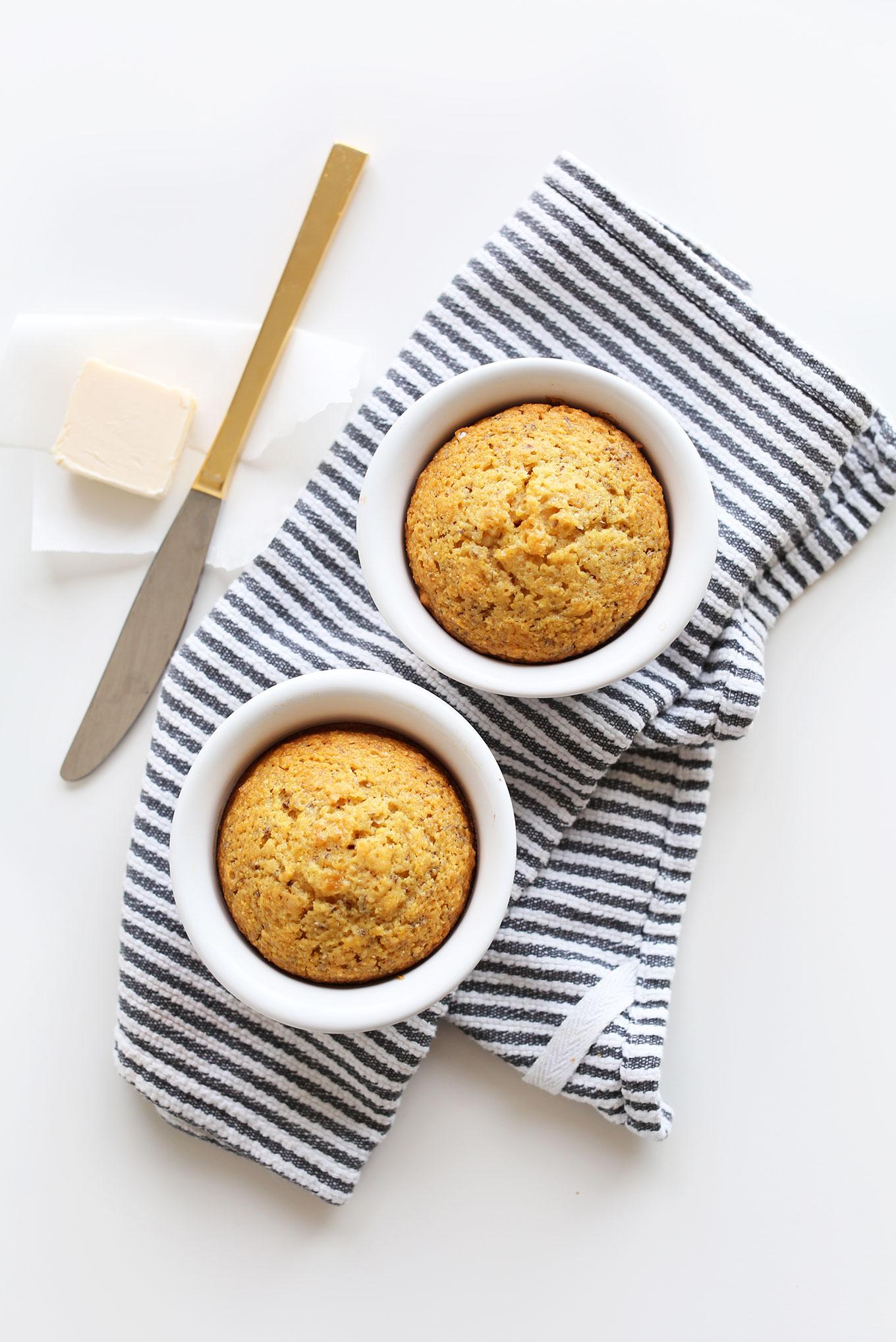 Freshly baked vegan cornbread muffins in ramekins