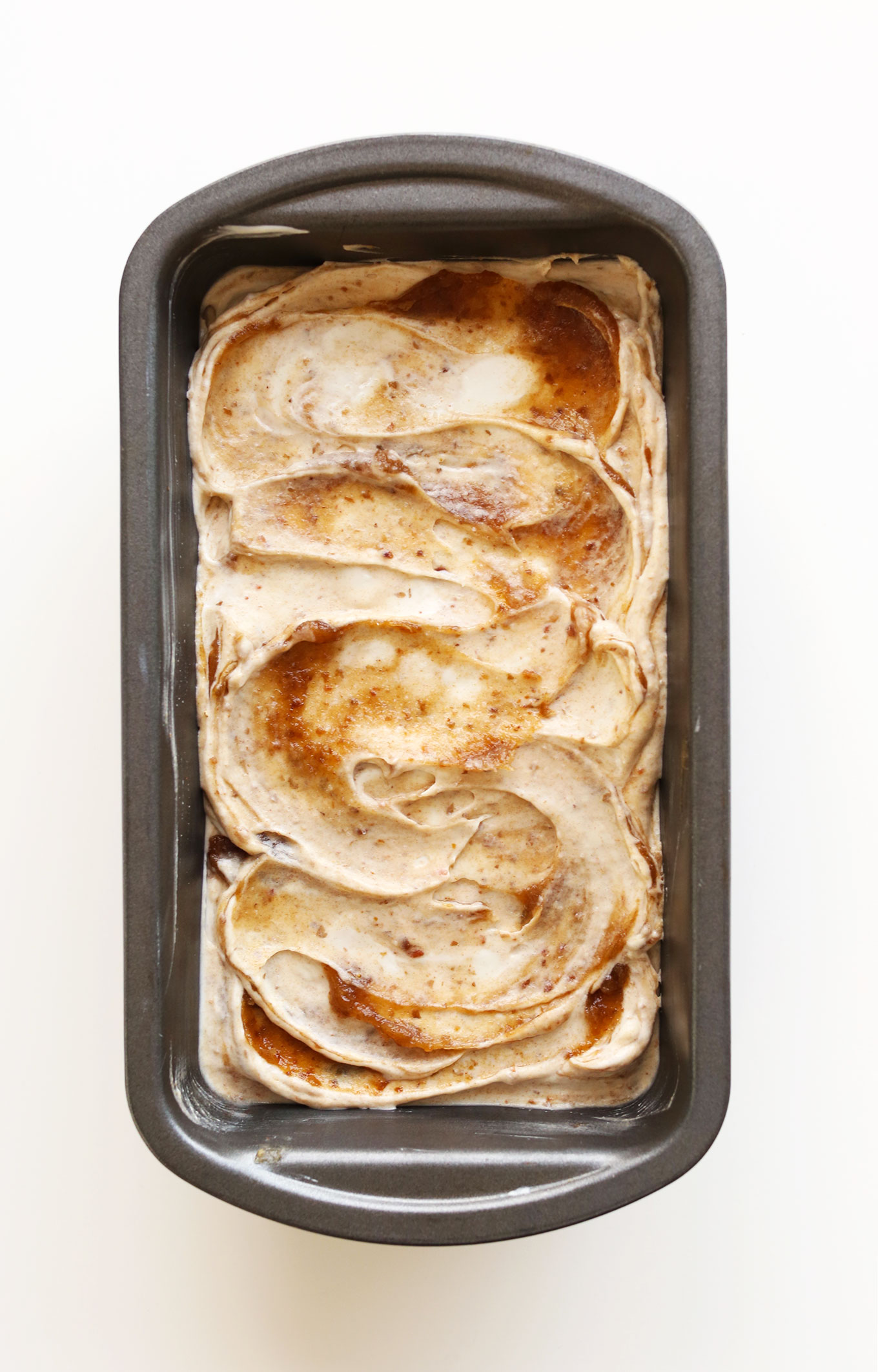 Baking pan filled with our Vegan Coconut Ice Cream with a Sea Salt Caramel swirl