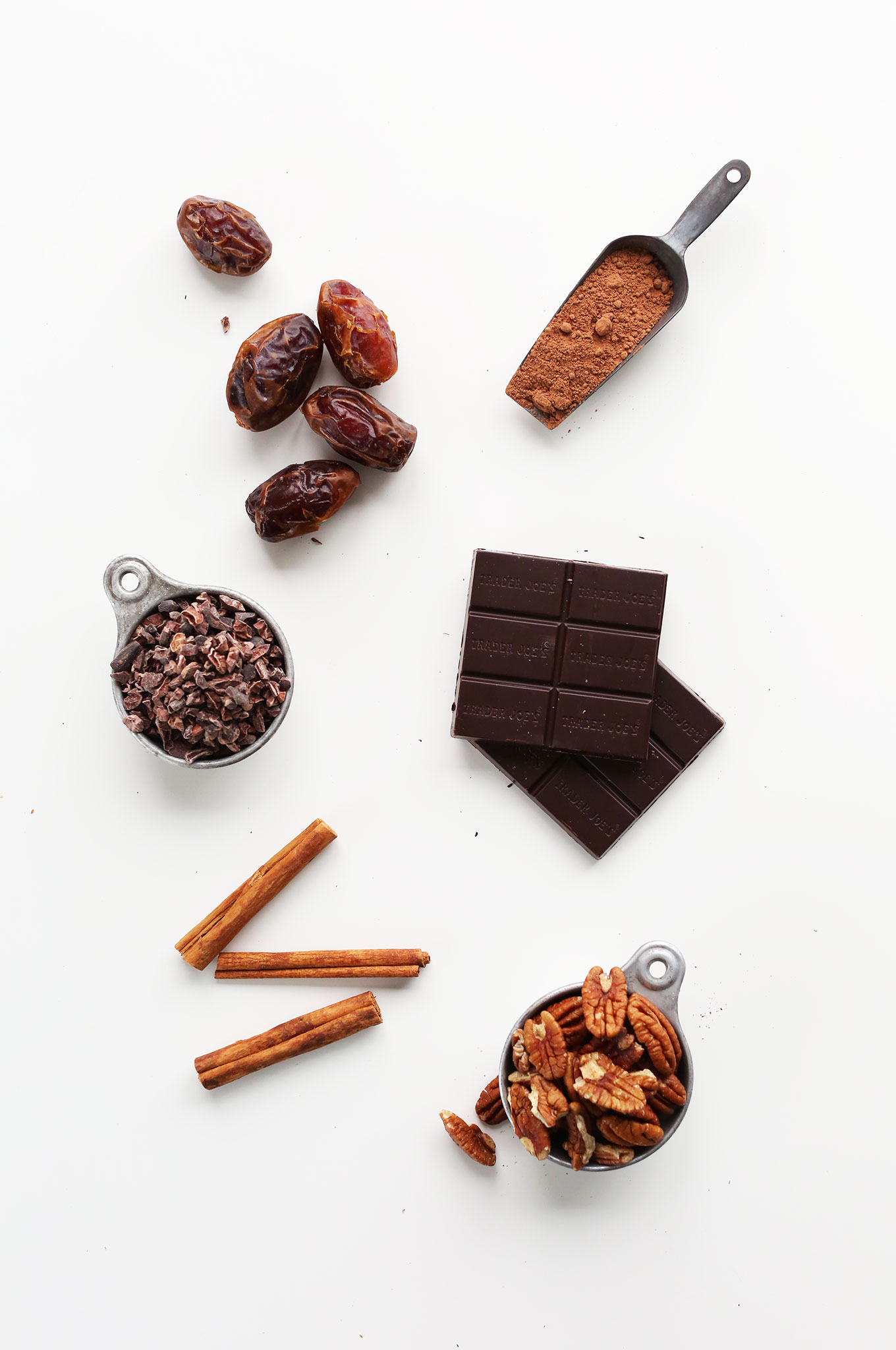 Cinnamon, pecans, dark chocolate, cocoa powder, dates, and cacao nibs