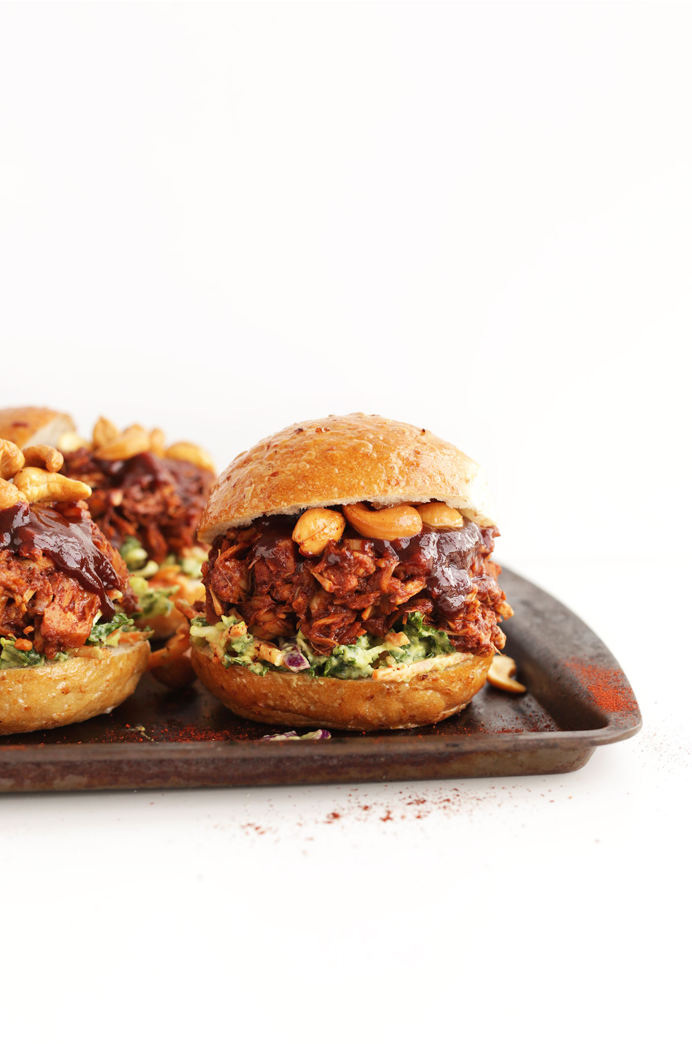 Baking sheet filled with our BBQ Jackfruit Sandwiches with Avocado Slaw and Roasted Cashews