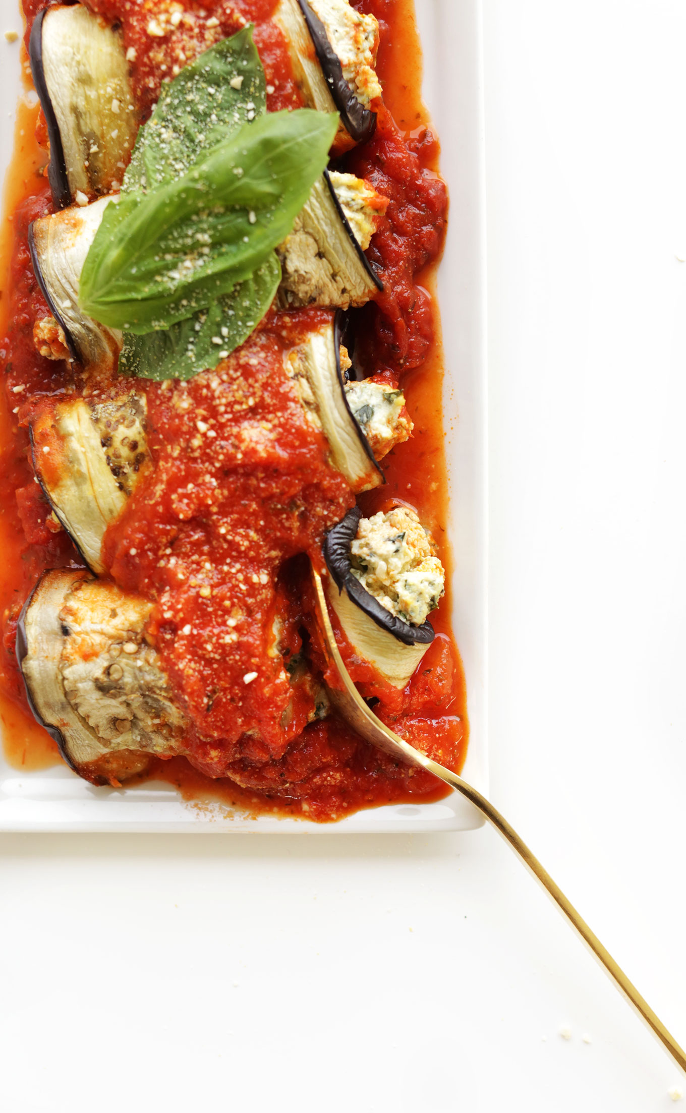 Using a fork to grab a bite of a delicious gluten-free vegan Eggplant Lasagna Roll-Up