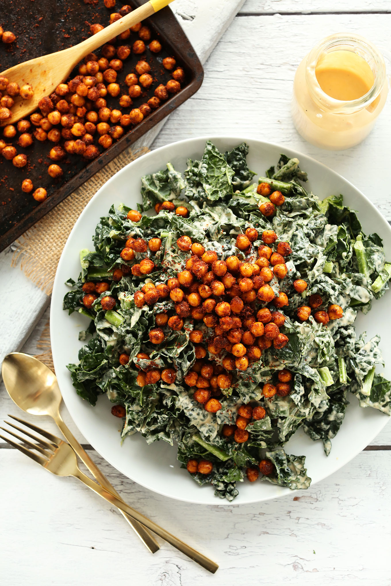 Dinner plate filled with our quick vegan Garlicky Kale Salad with Tandoori Spiced Chickpeas
