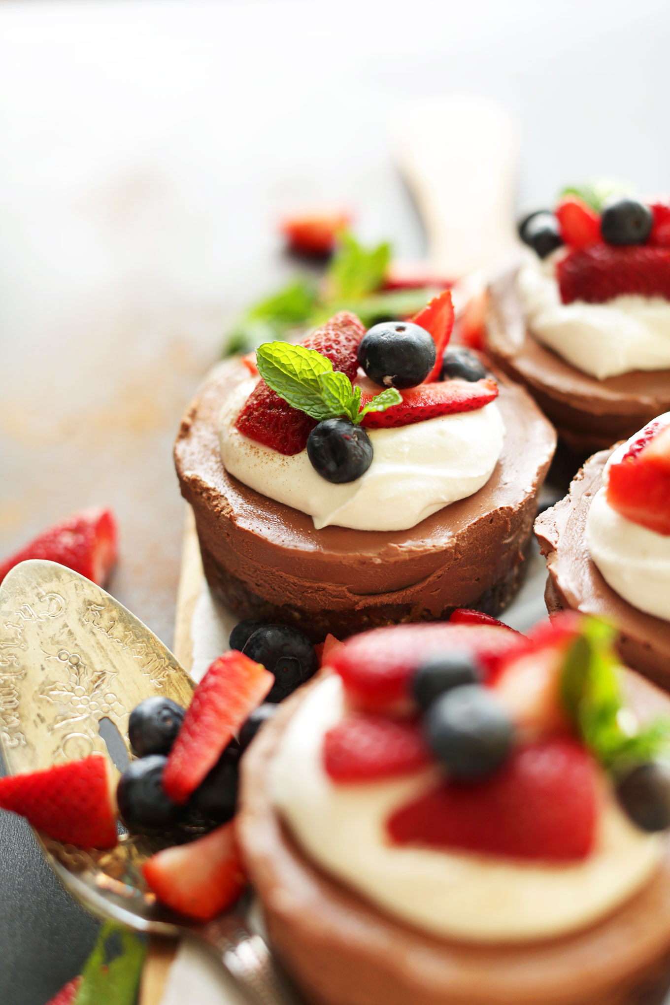 Mini Vegan Chocolate Cheesecakes With Coconut Whip And Fresh Berries