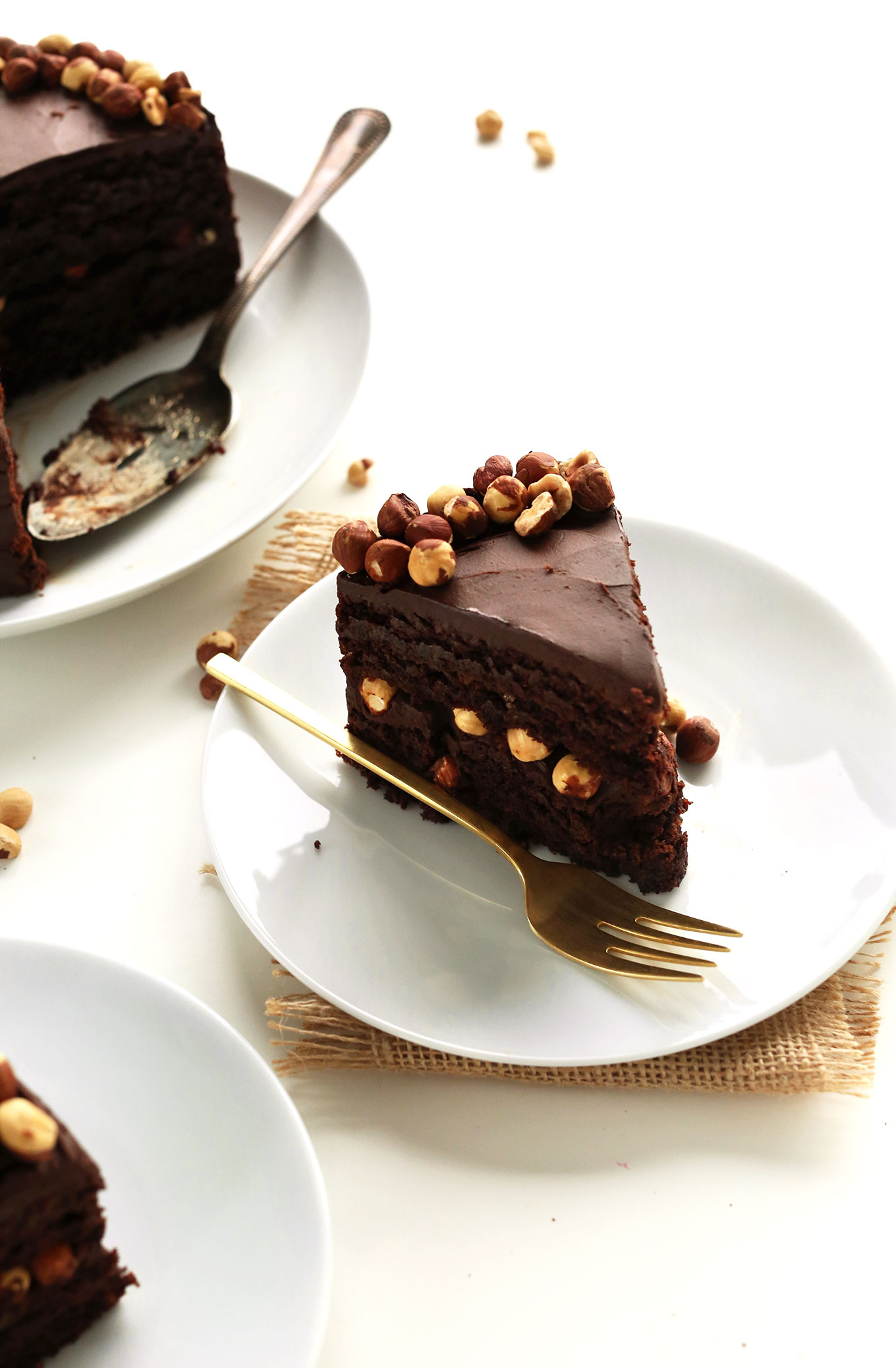 Plates of sliced Vegan Gluten-Free Chocolate Hazelnut Cake
