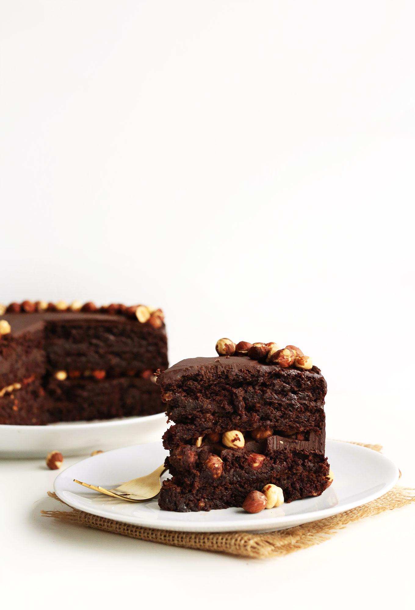 Slice of super rich gluten-free Vegan Chocolate Hazelnut Cake for dessert