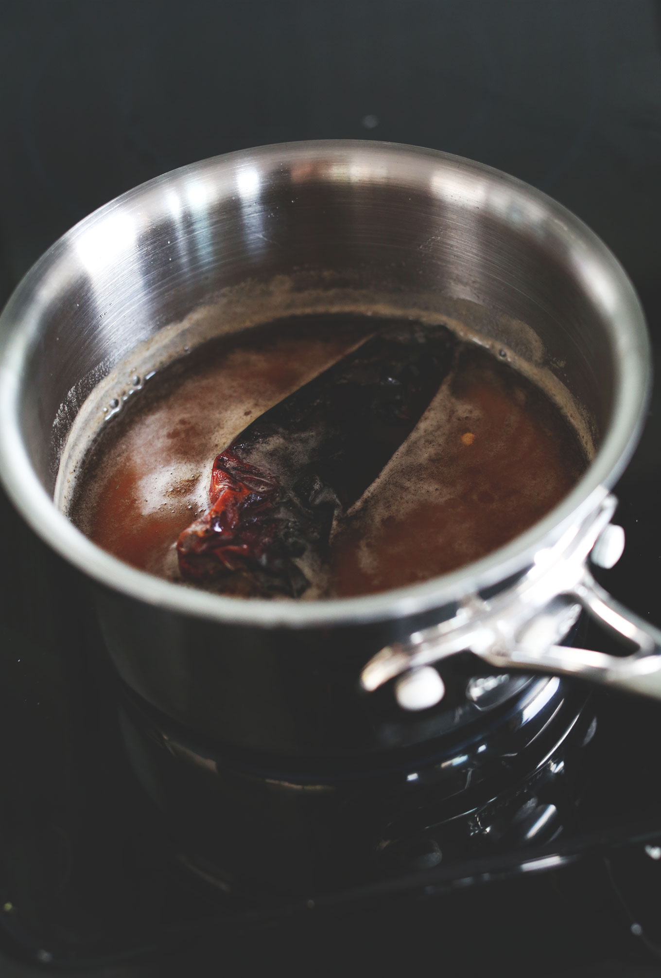 Making Cinnamon Chili Simple Syrup in a saucepan