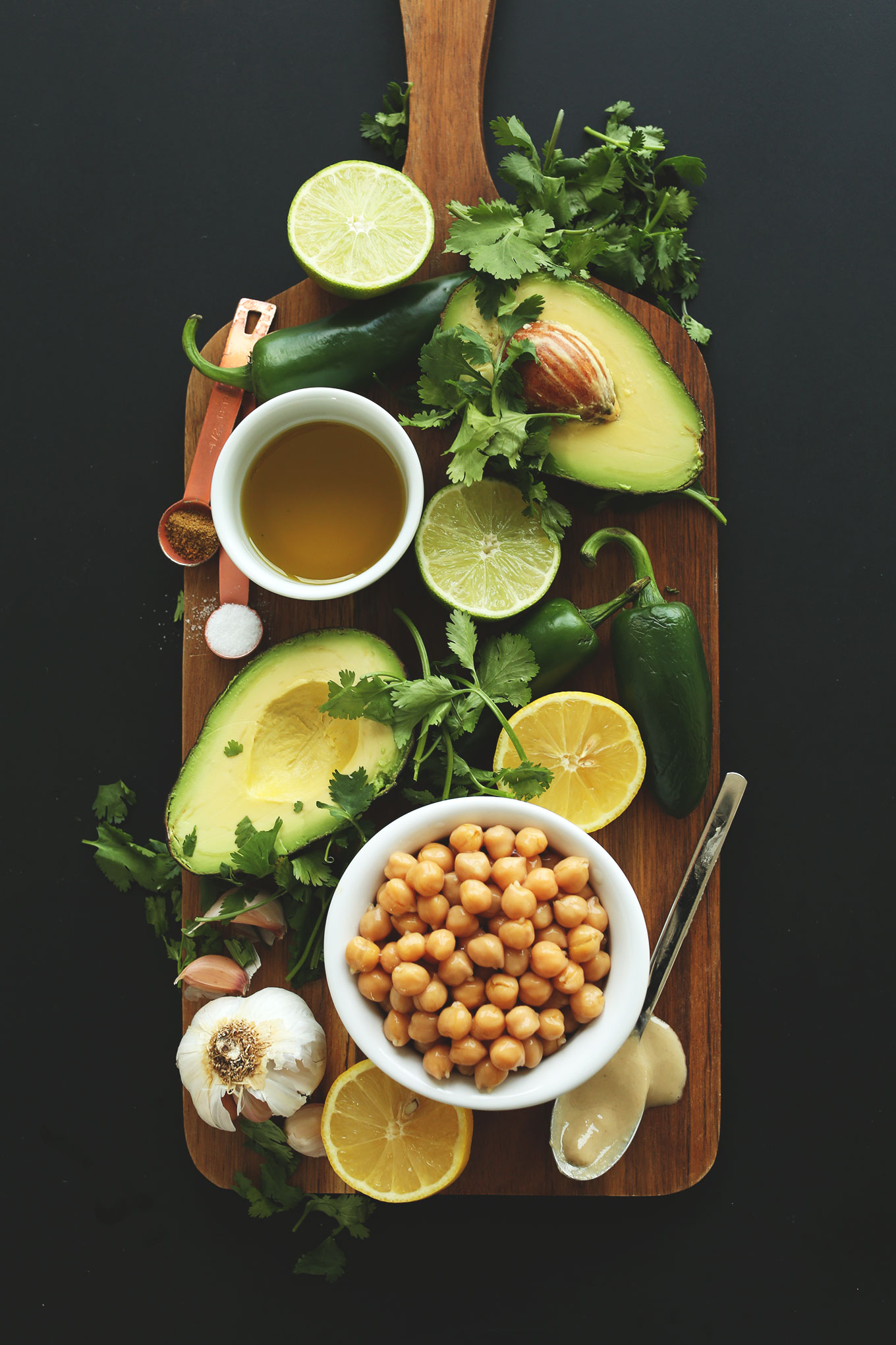 Cutting board with ingredients for making our delicious and healthy Creamy Roasted Jalapeno Hummus