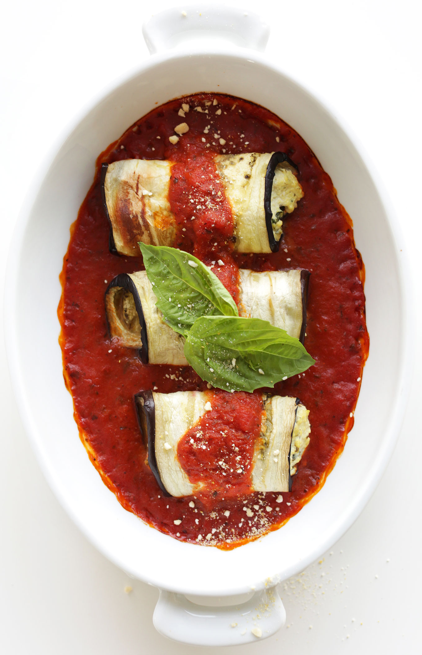 Baking dish filled with Eggplant Lasagna Roll Ups for a satisfying gluten-free vegan meal