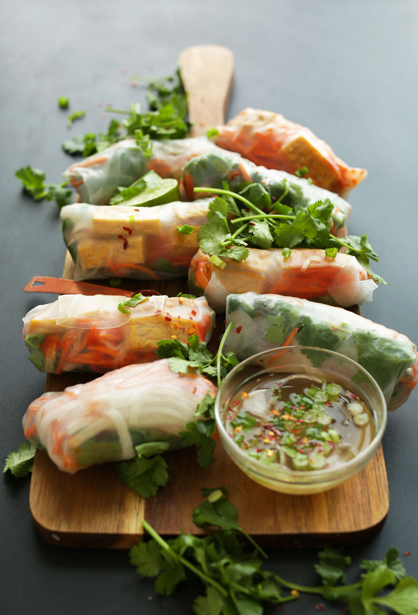 Wood cutting board filled with our gluten-free vegan Bahn Mi Spring Rolls recipe