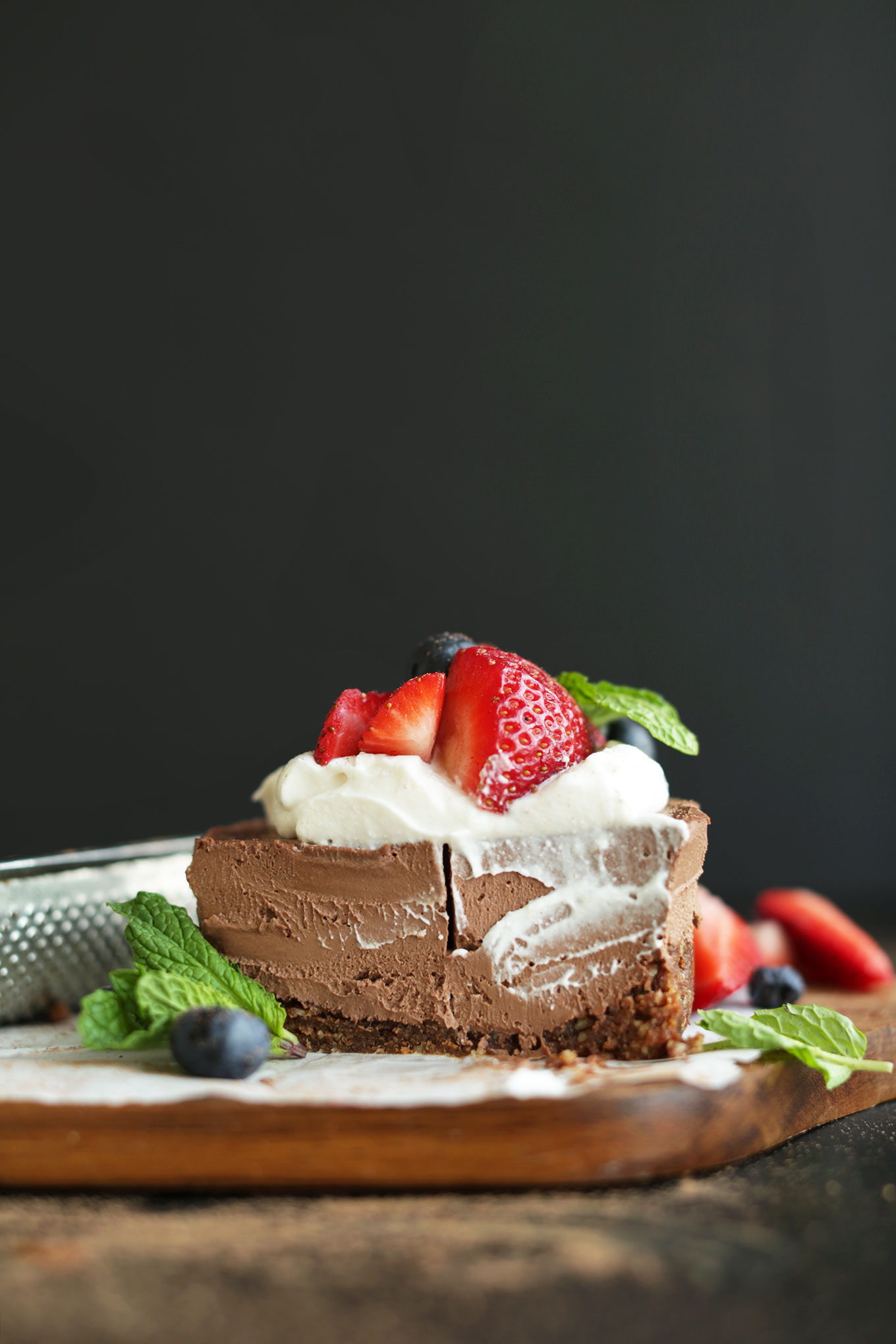 Halved mini Vegan Chocolate Cheesecake revealing its creamy texture