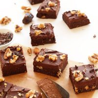 Batch of Raw Vegan Brownies cut into squares and topped with walnuts