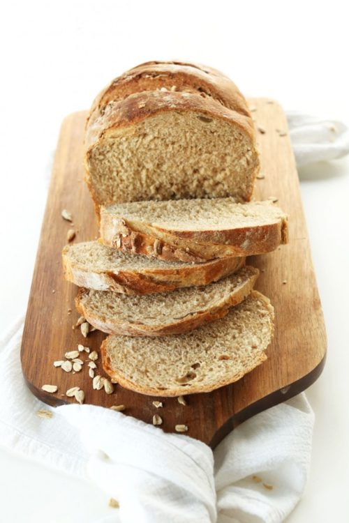 Sliced easy homemade Whole Grain Vegan Bread on a cutting board