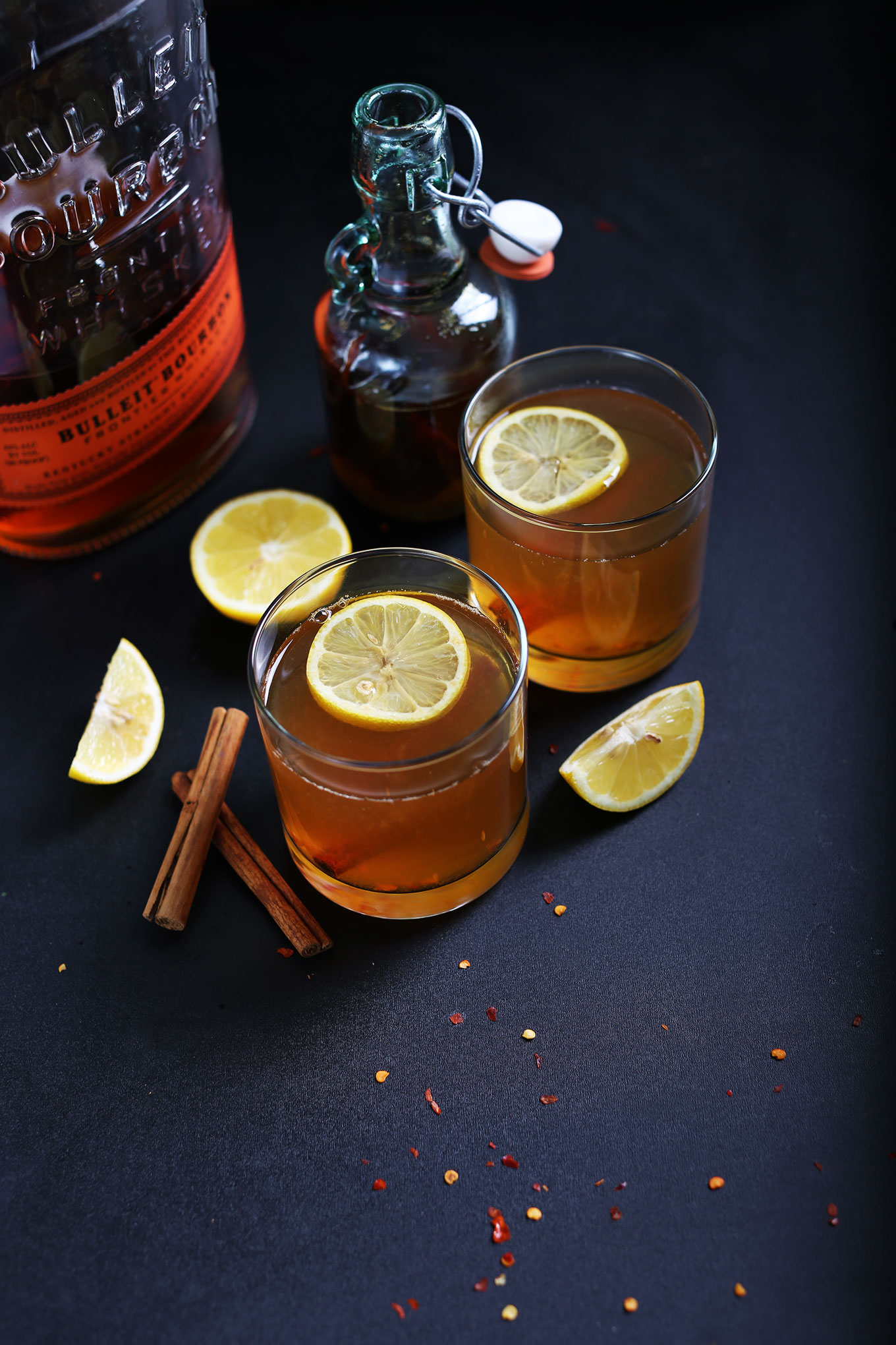 Glasses of our sweet and soothing Chili Cinnamon Hot Toddy recipe made with Bourbon and Lemon
