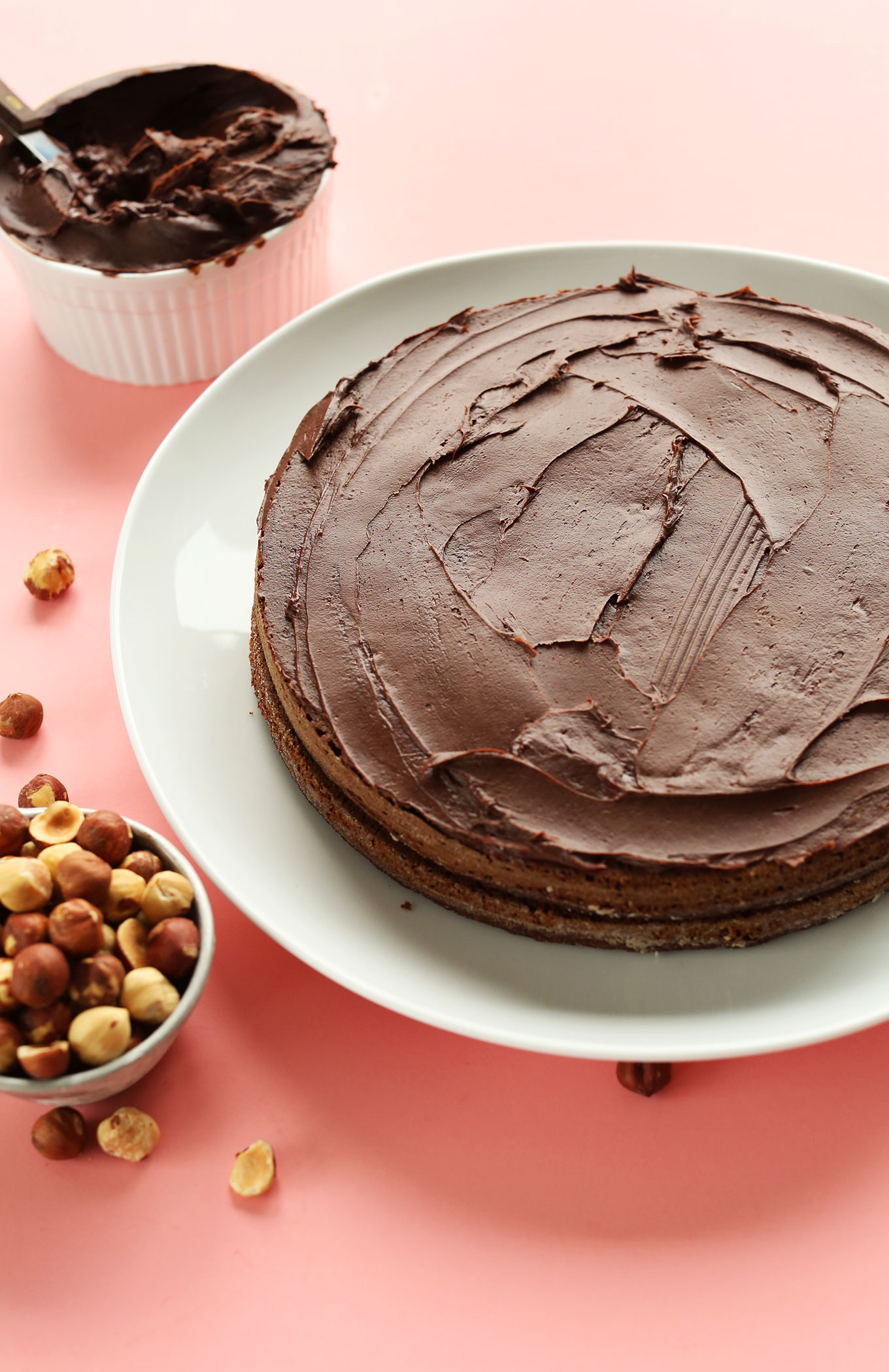 Two layers of our gluten-free vegan Chocolate Hazelnut Cake recipe with rich chocolate frosting