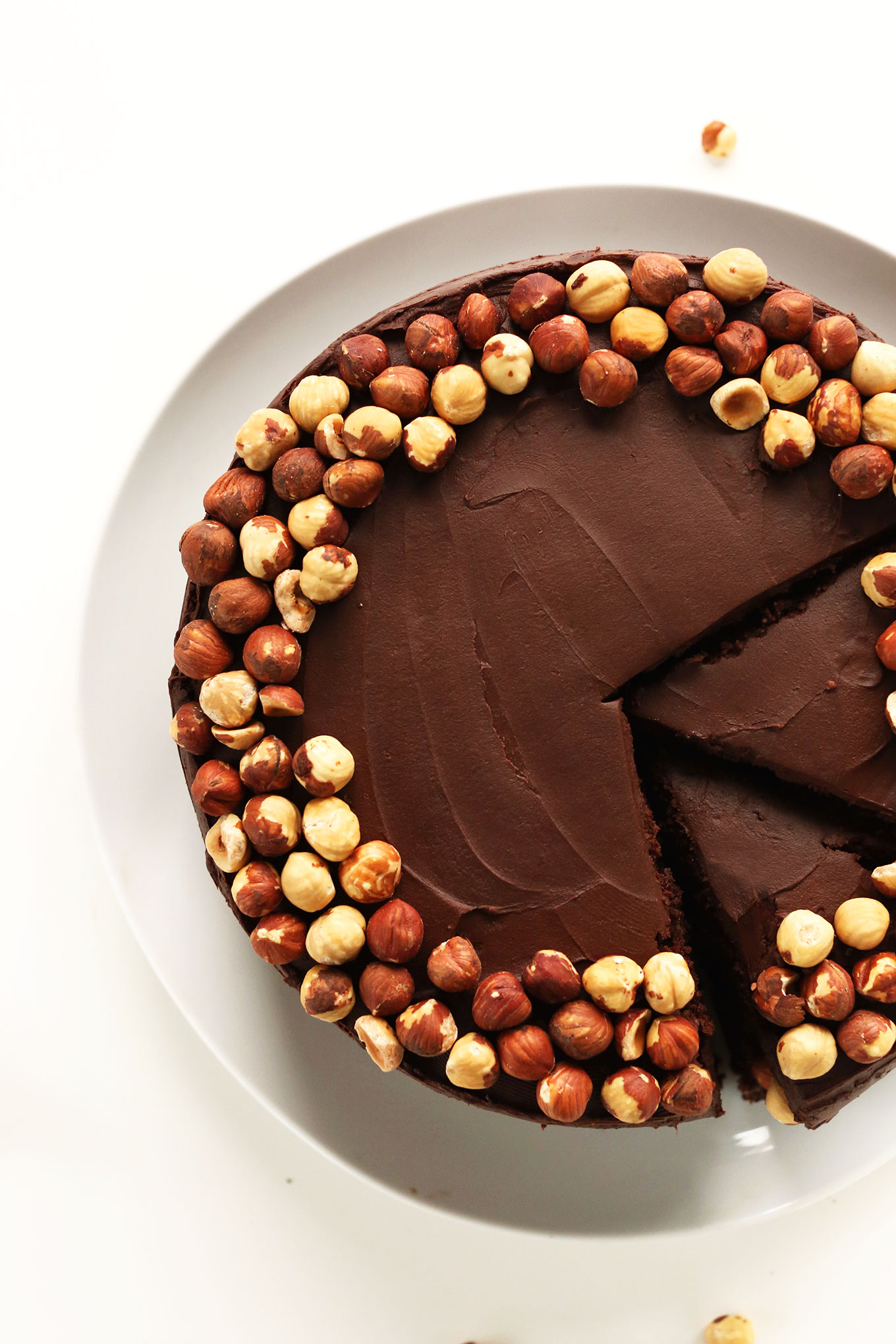 Partially sliced gluten-free vegan Chocolate Hazelnut Cake