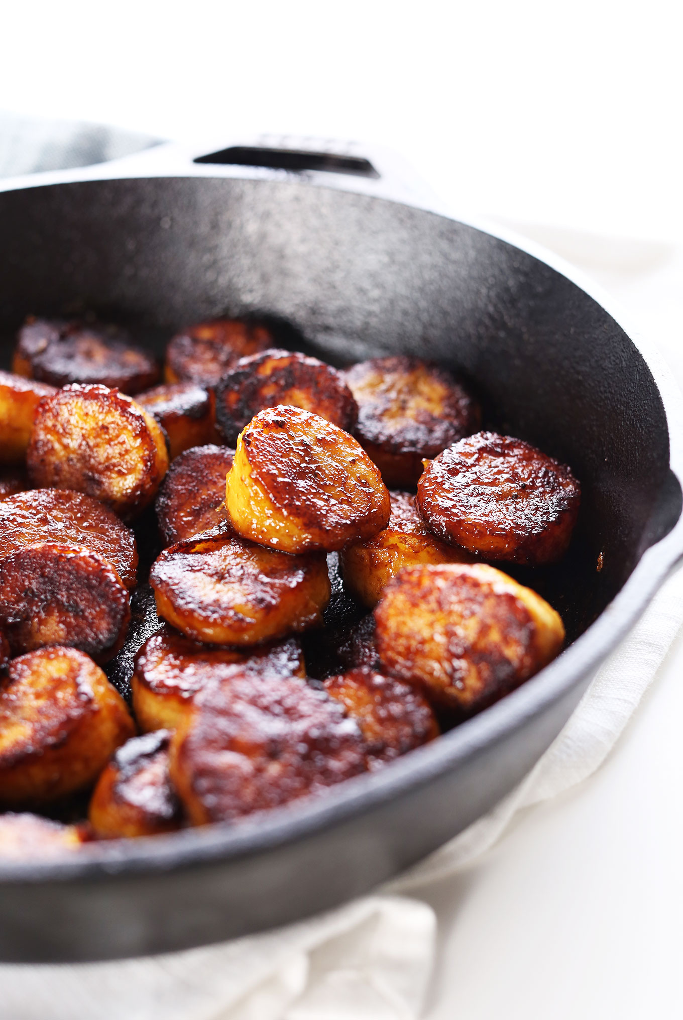 Easy Vegan Caramelized Plantains in a cast-iron skillet