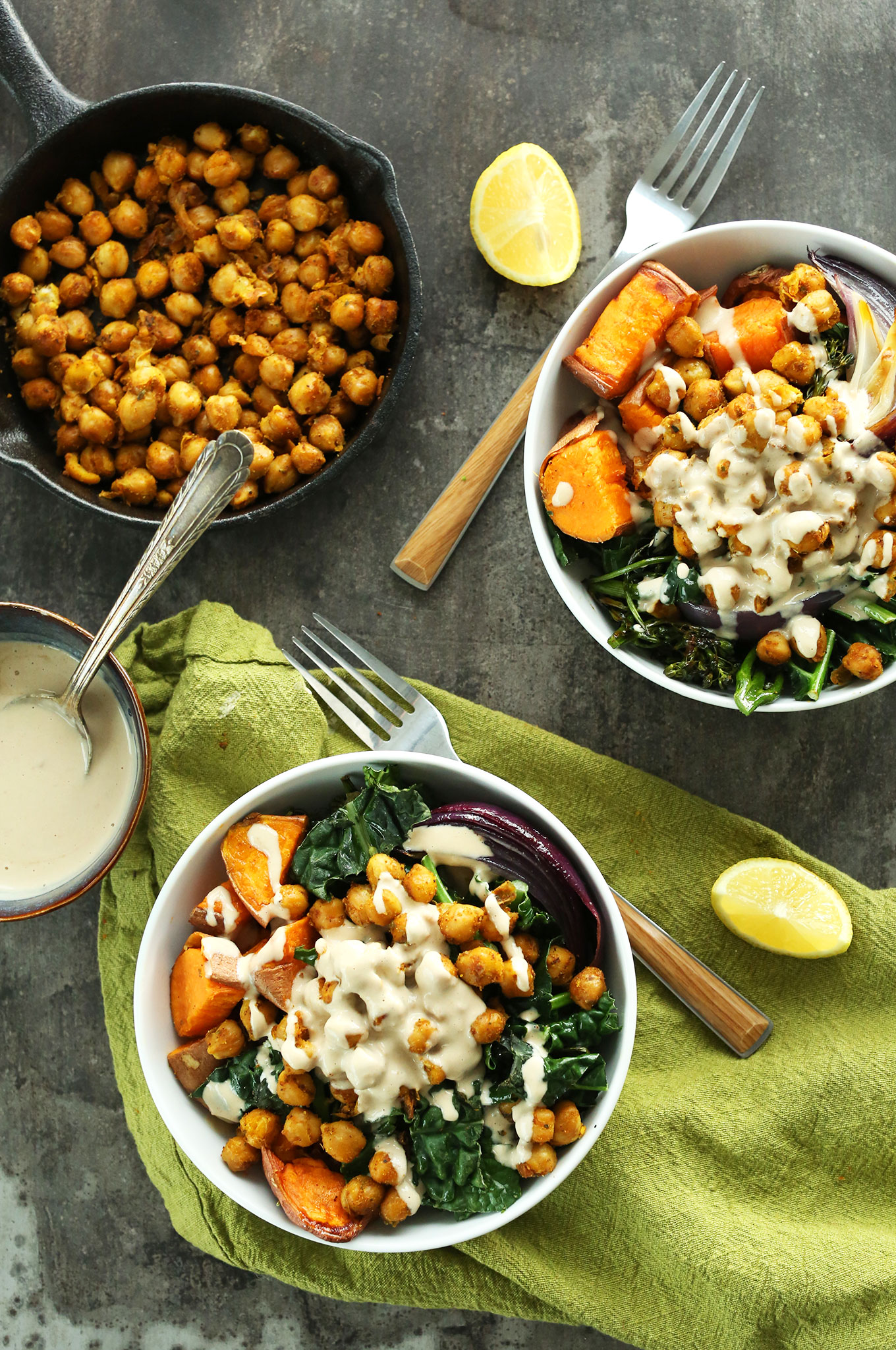 Chickpea Sweet Potato Buddha Bowls with extra chickpeas in a cast-iron skillet