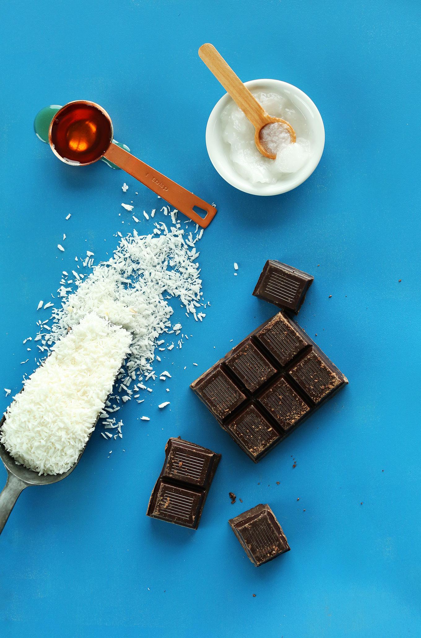 AMAZING 5-Ingredient Coconut Macaroons dipped in Dark Chocolate! #vegan #glutenfree #minimalistbaker