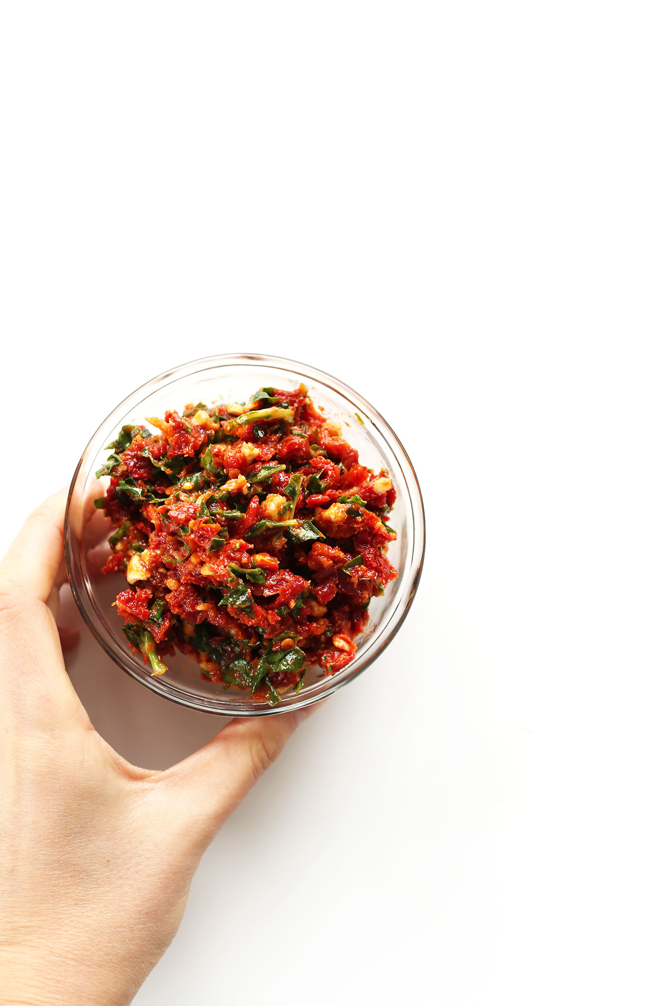 Small bowl filled with our simple Sun-Dried Tomato Pesto
