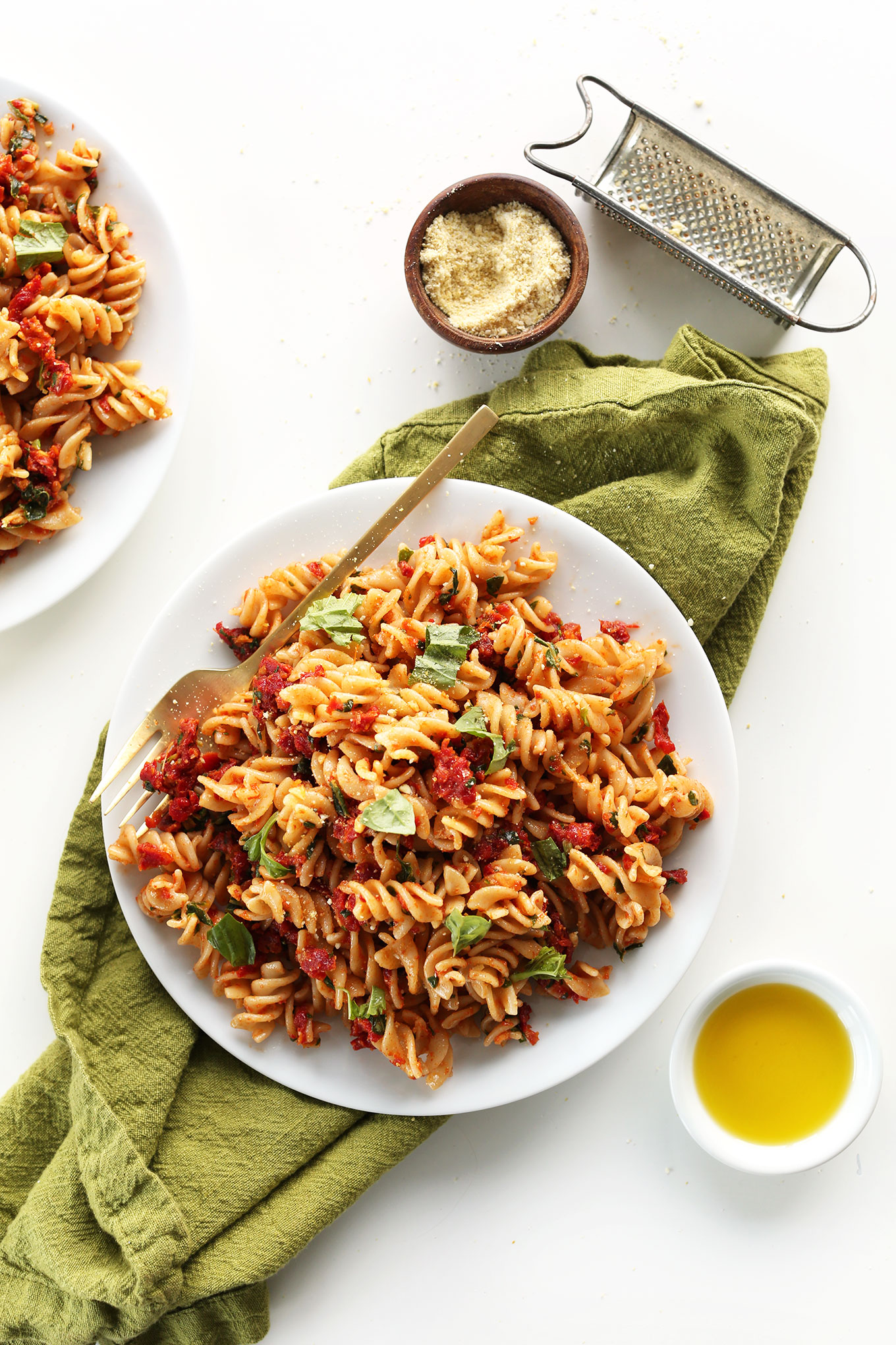 Dinner plate filled with our delicious and simple Sun-Dried Tomato Pesto Pasta