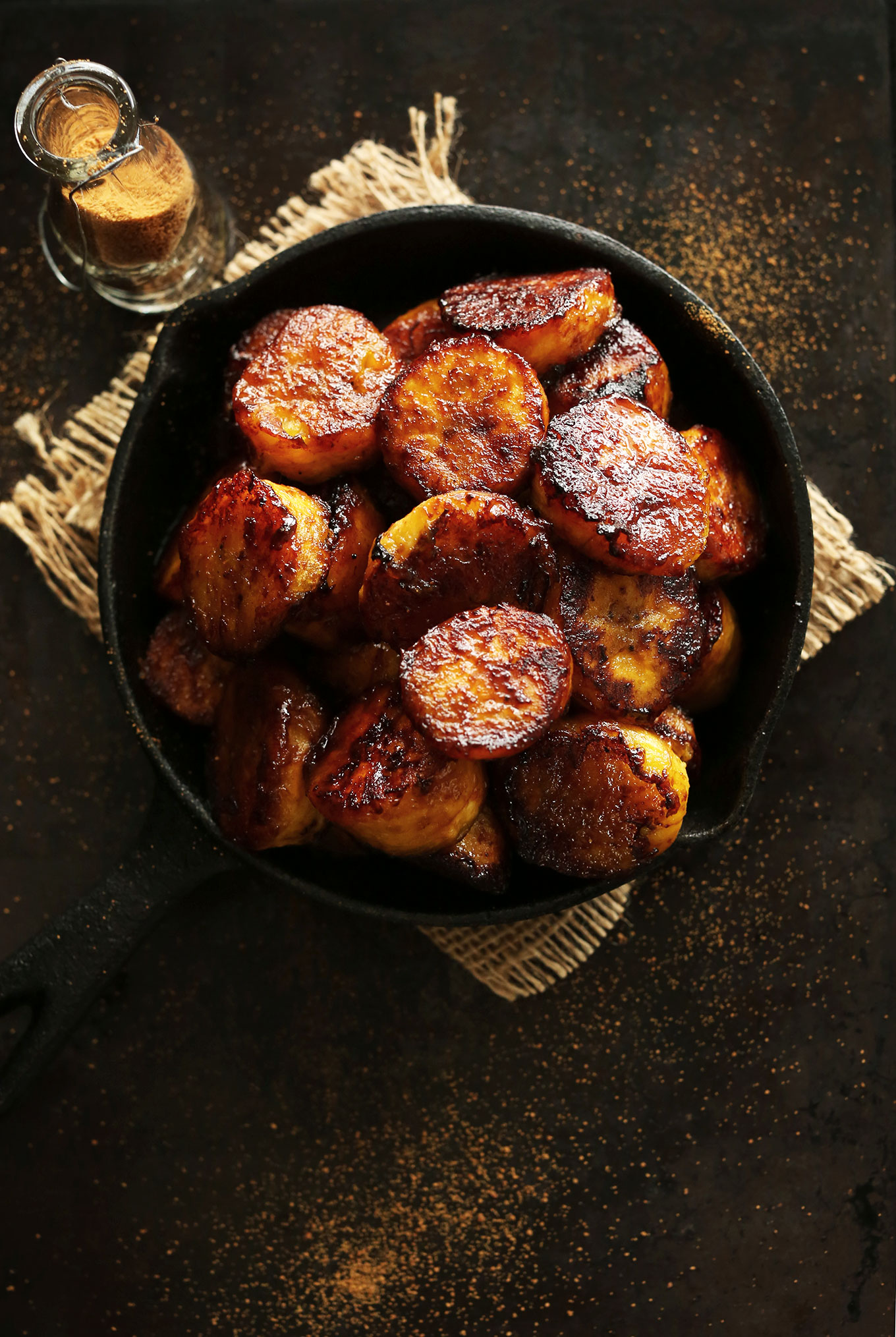 Cast-iron skillet filled with perfectly Caramelized Plantains