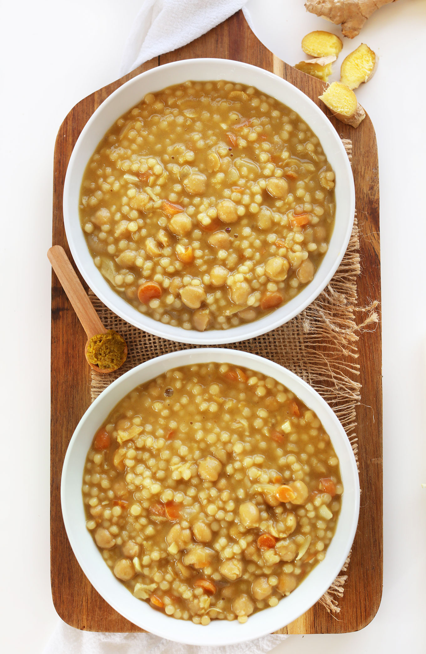 Bowls of Green Chickpea Curry with Israeli Couscous for a healthy vegan meal