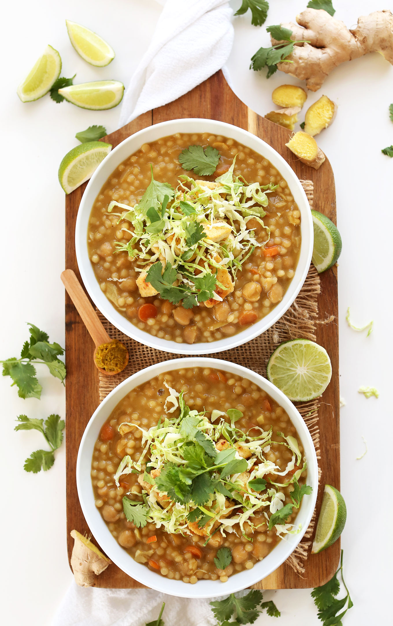 Bowls of Green Chickpea Curry with Israeli Couscous for a quick vegan dinner