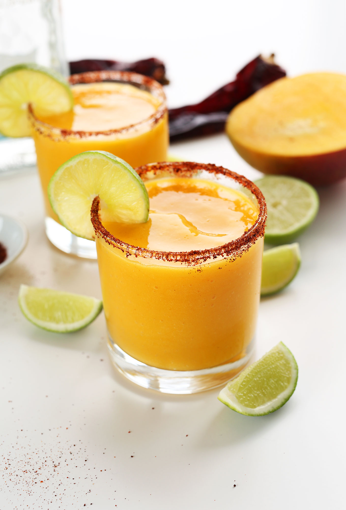 Glasses of our Easy Mango Chili Lime Margaritas recipe for a delicious summer drink