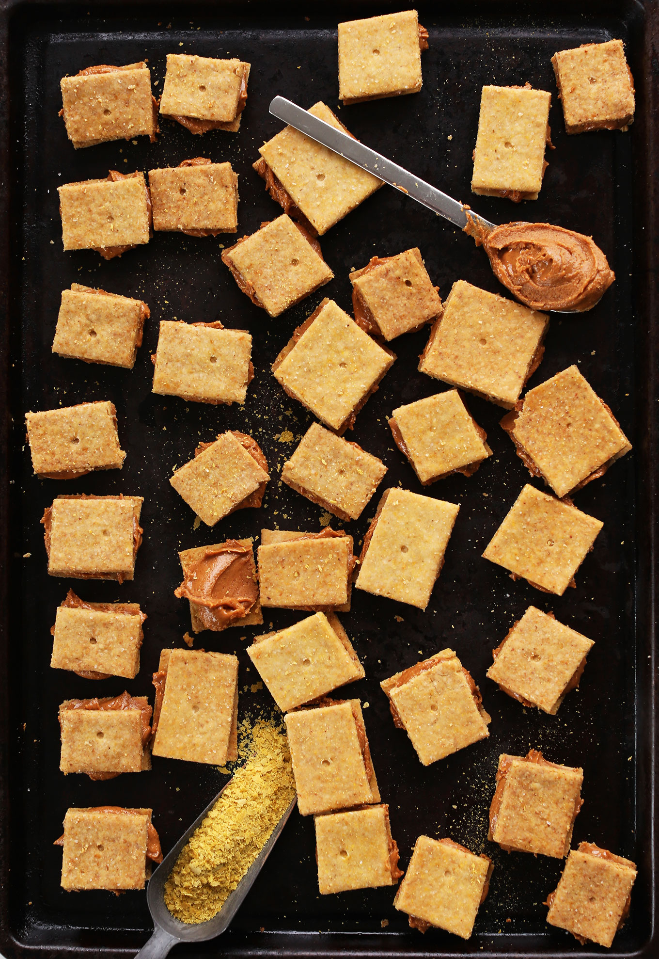 Baking sheet filled with Peanut Butter Cheese Crackers for a healthy gluten-free vegan snack