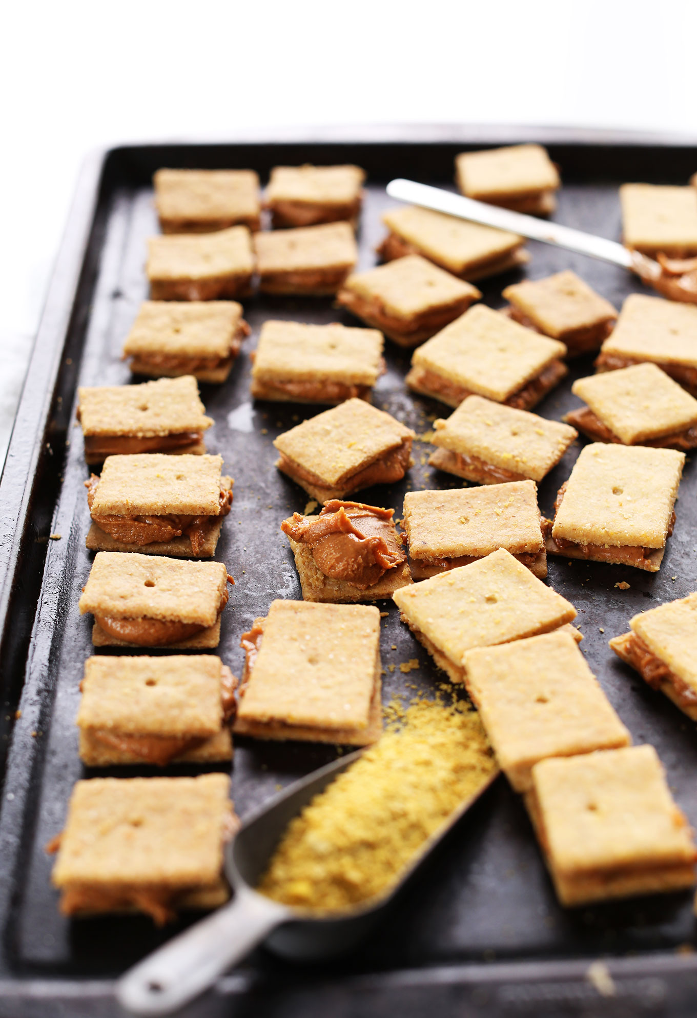 Baking sheet filled with homemade gluten-free vegan Peanut Butter Cheese Crackers