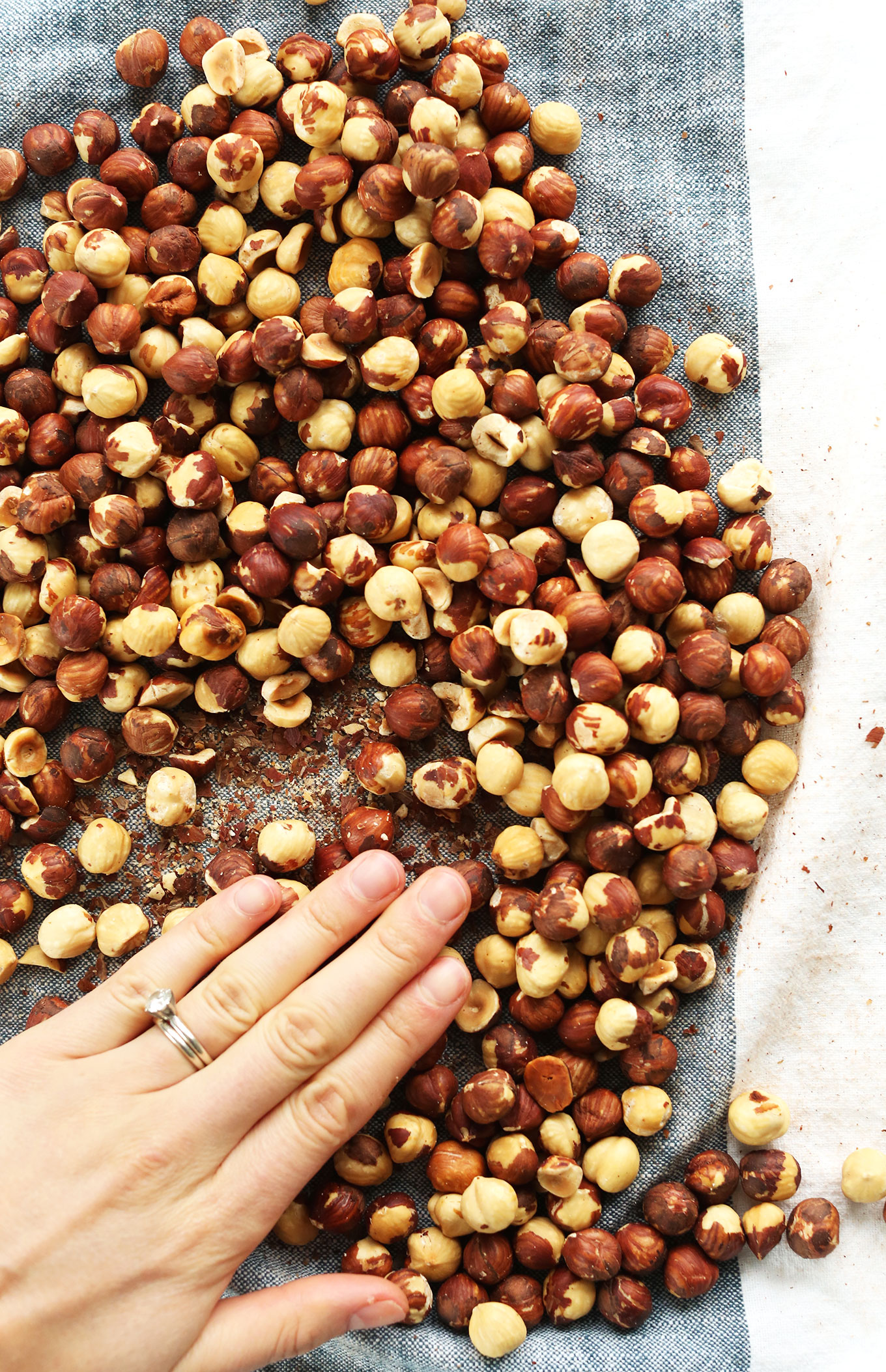 Rolling roasted hazelnuts in a towel to remove skins