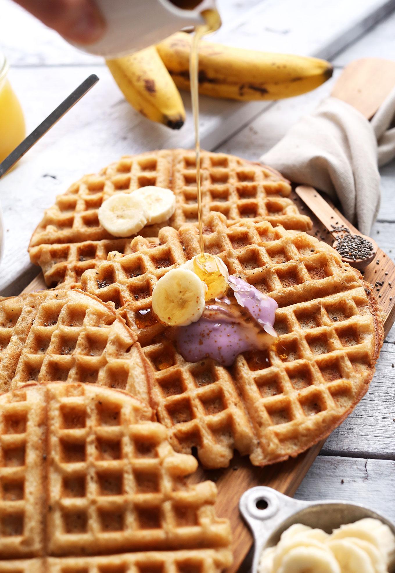 Pouring syrup onto a Vegan GF Yogurt Waffle