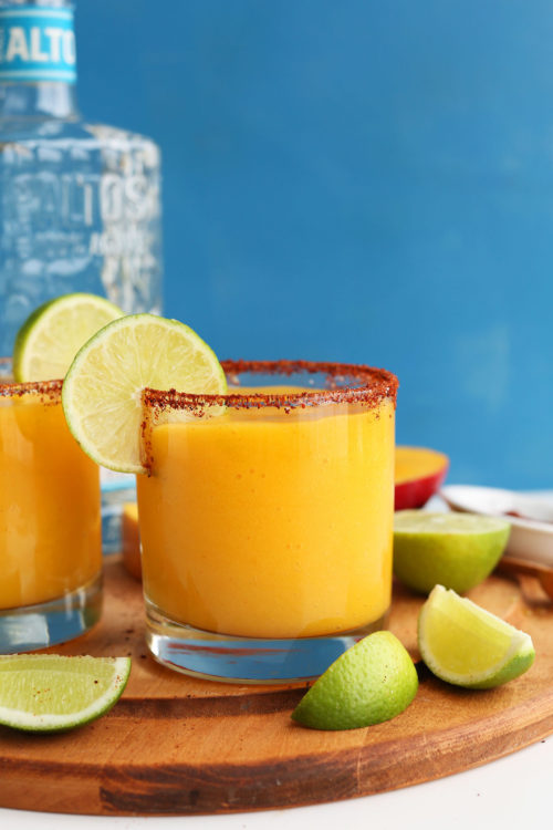 Glasses of our Mango Chili Lime Margaritas for a summertime vegan drink