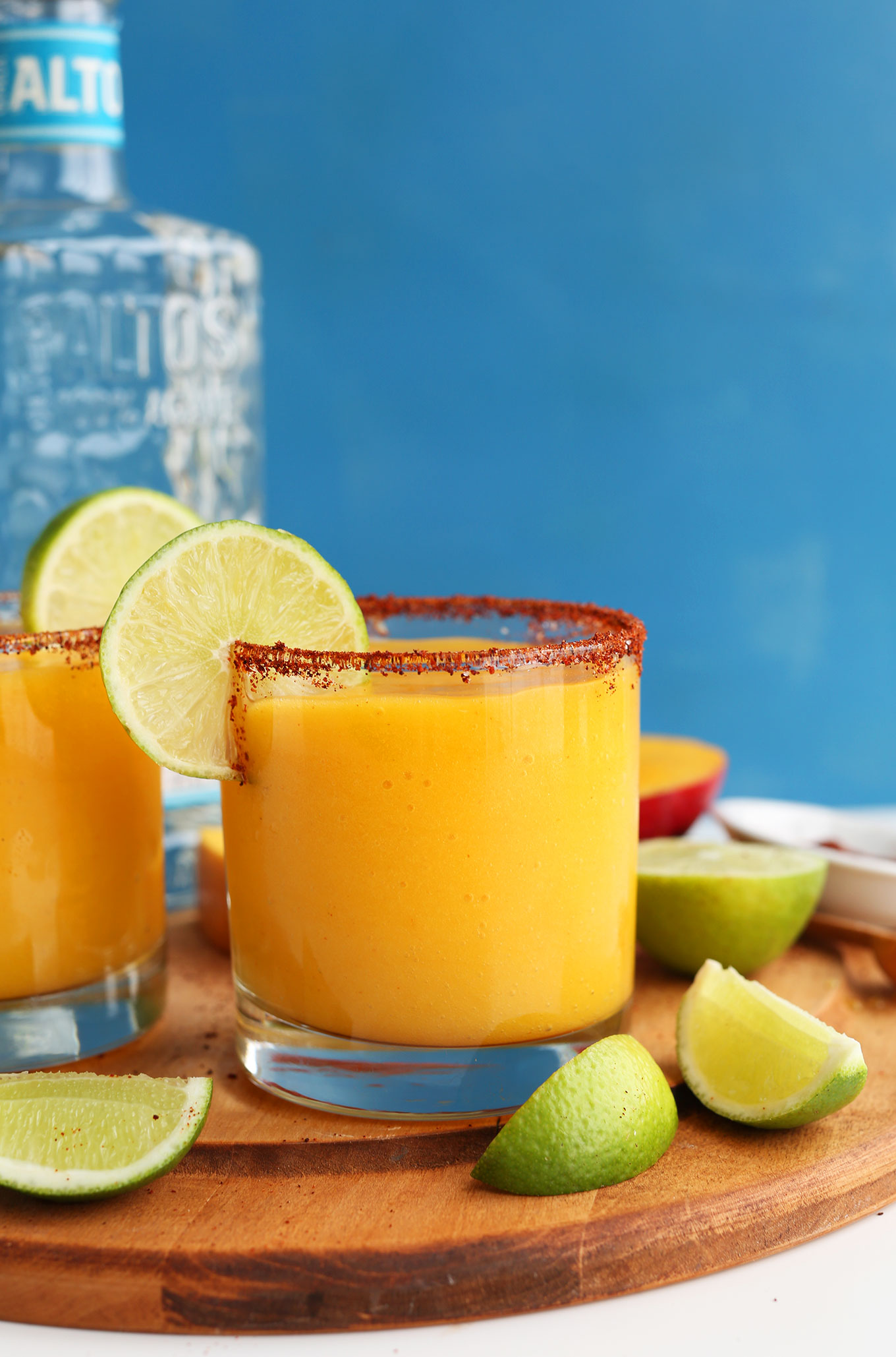 Glasses filled with our Mango Chili Lime Margaritas with a chili powder and fresh lime rim