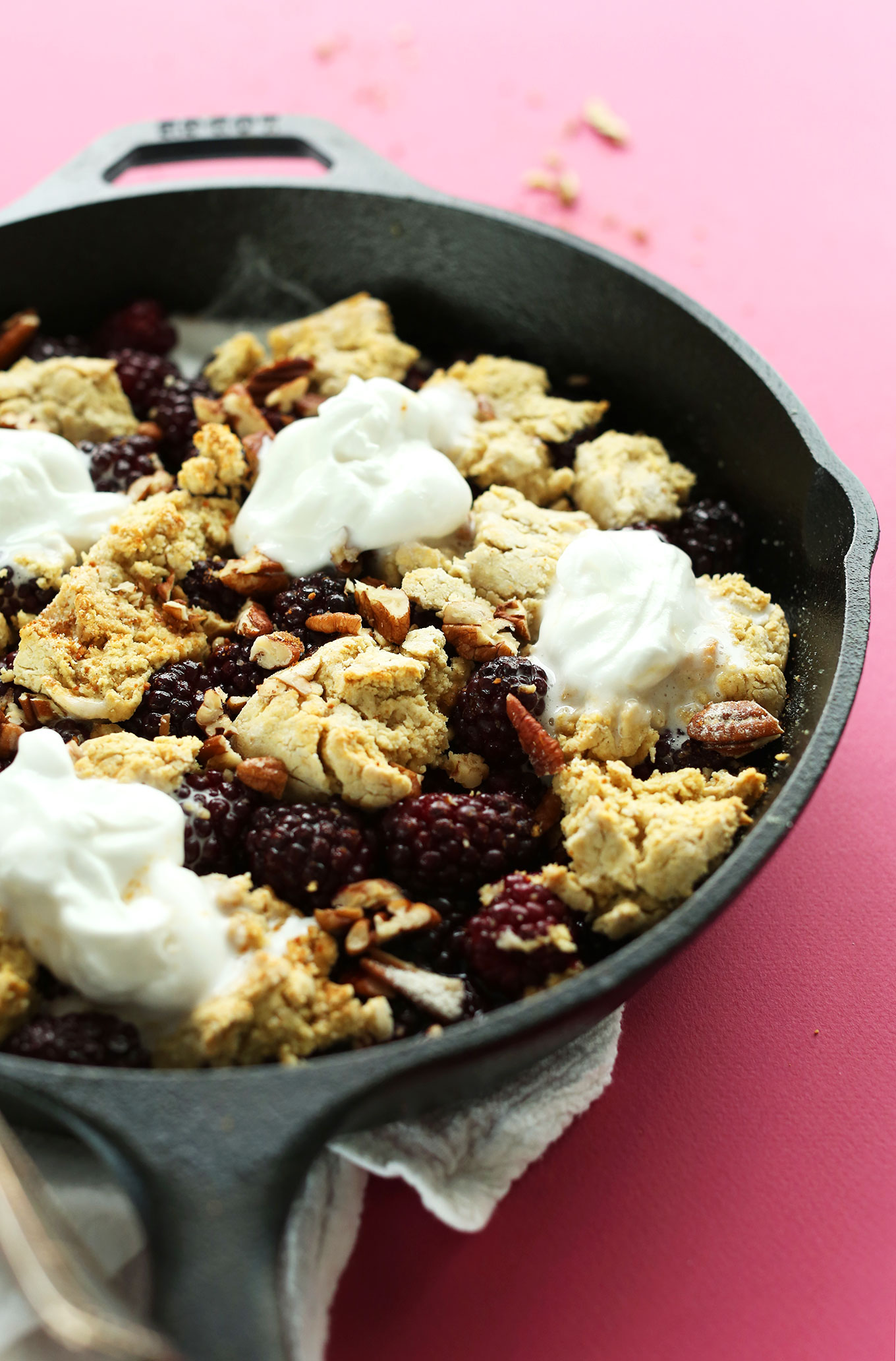 Cast-iron skillet with freshly baked gluten-free vegan Blackberry Cobbler