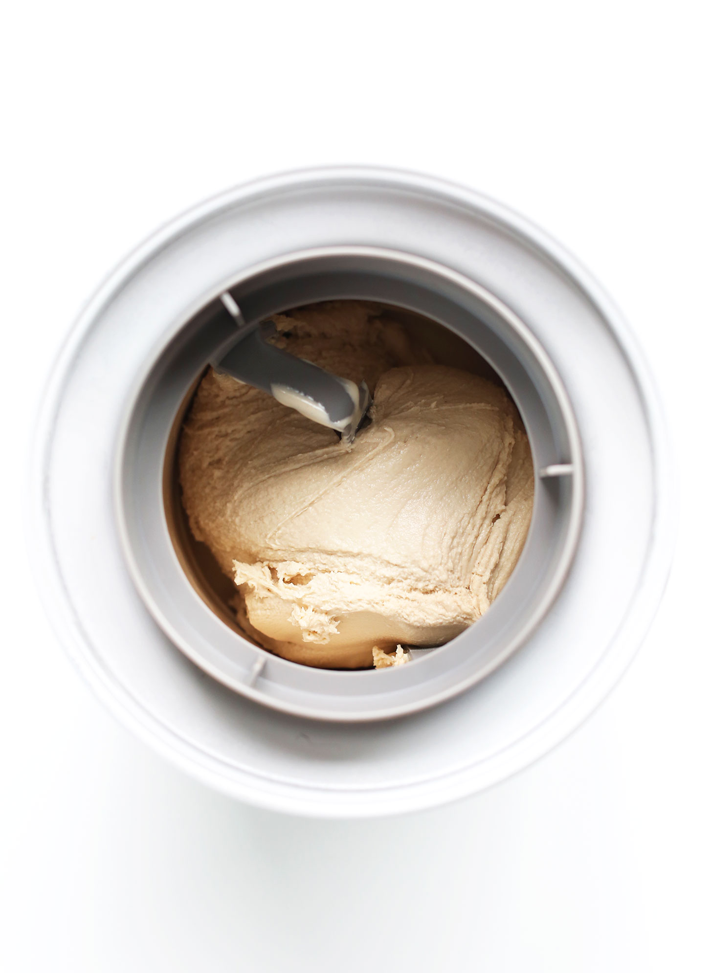 Churning homemade ice cream in an ice cream maker