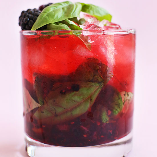 Glass filled with our Blackberry Basil Mojito recipe