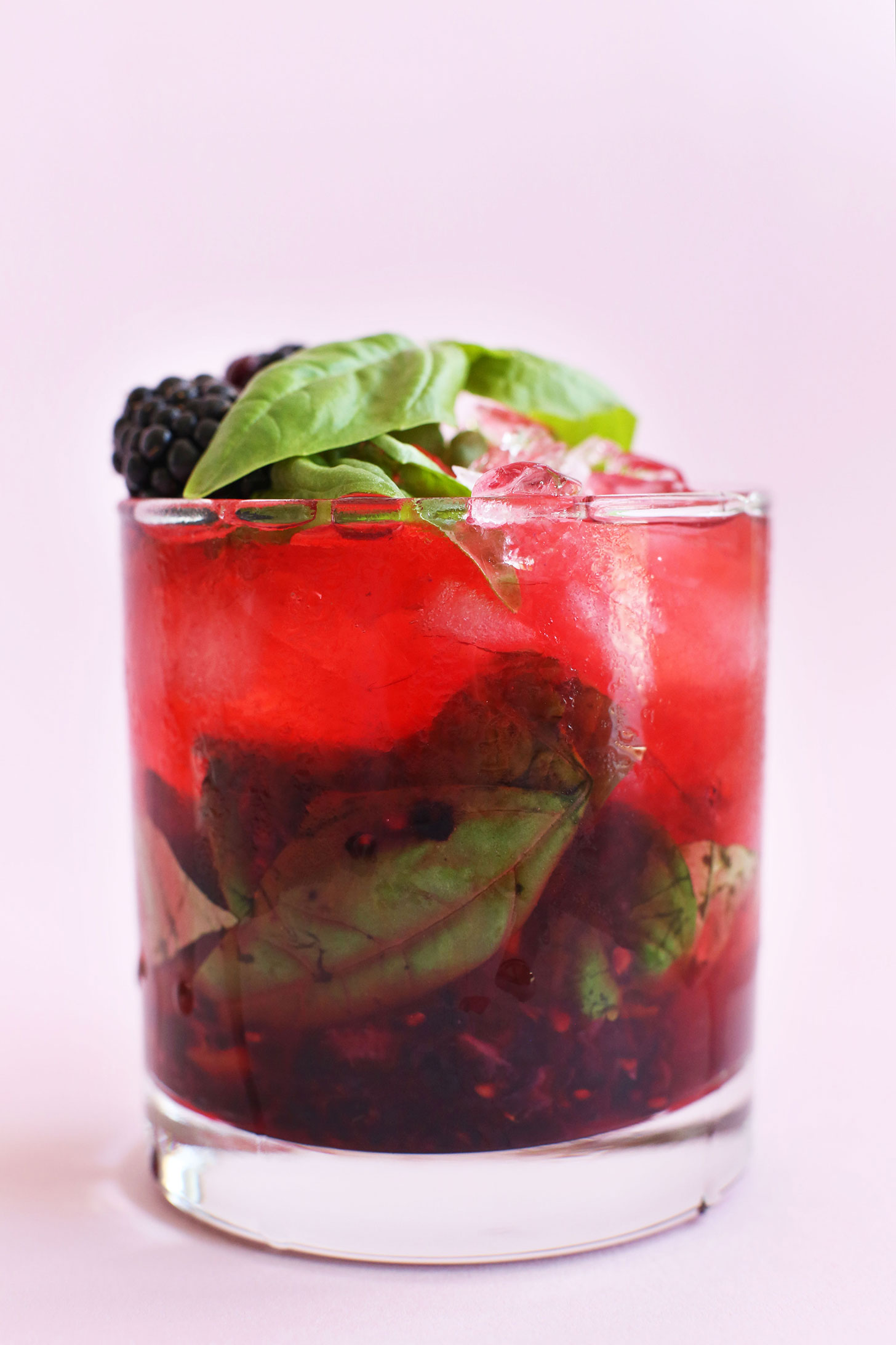 Glass of our Summery Blackberry Basil Mojito recipe for a refreshing, tart, and sweet cocktail