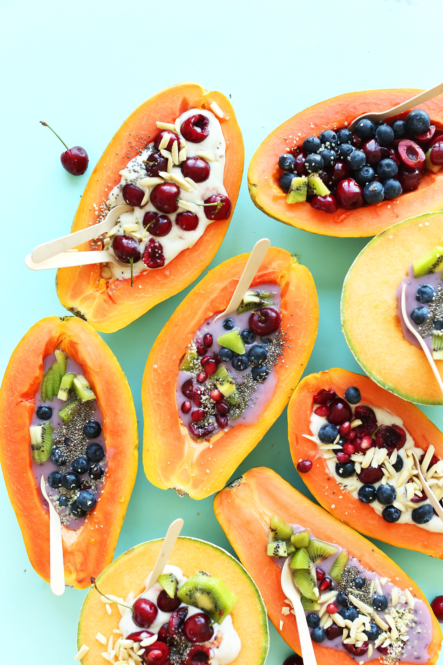 Papaya Boats filled with various toppings for a healthy gluten-free vegan snack