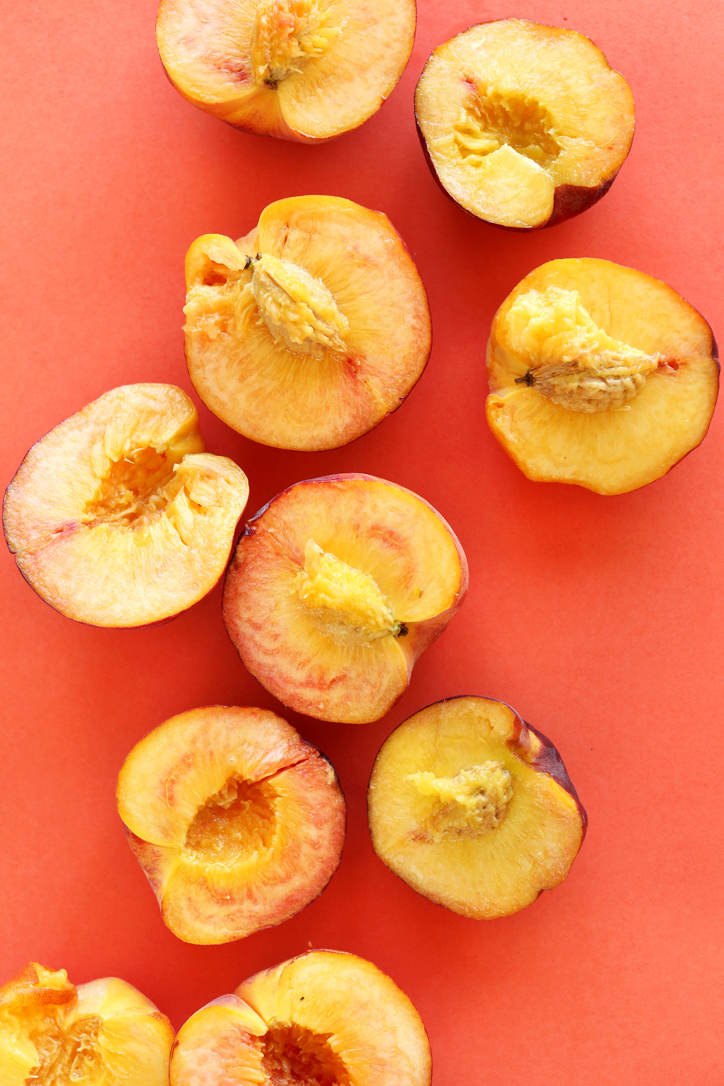 Halved fresh peaches for making gluten-free vegan crisp