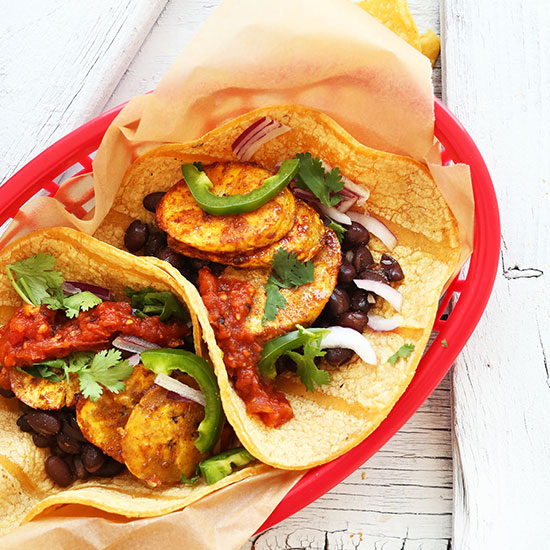 Basket filled with Spicy Plantain Black Bean Tacos