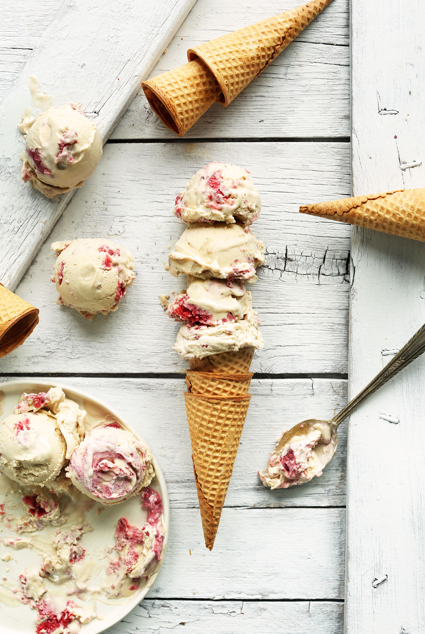 Sugar cone piled high with scoops of our delicious homemade vegan Raspberry Swirl ice cream