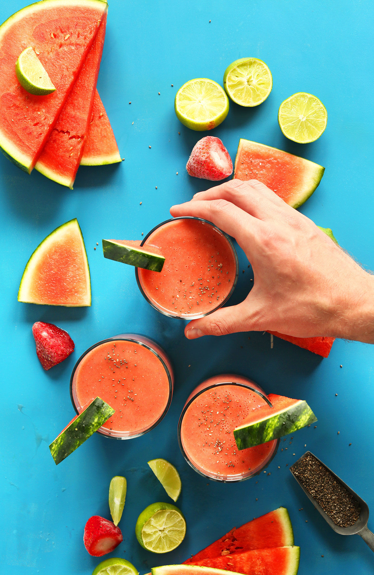 Grabbing a glass of our Refreshing Watermelon Smoothie with Strawberries, Lime, and Chia Seeds