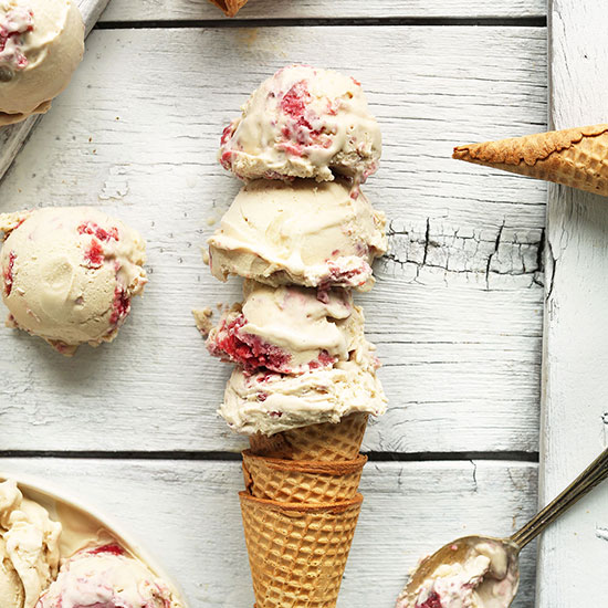 Stack of cones topped with scoops of homemade Raspberry Ripple Coconut Ice Cream